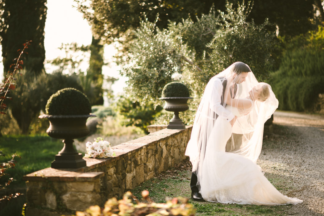 Bride in stunning Jesus Peiro gown and groom in Paul Smith elegant portrait at Villa Le Fontanelle for a fine art destination wedding in Florence