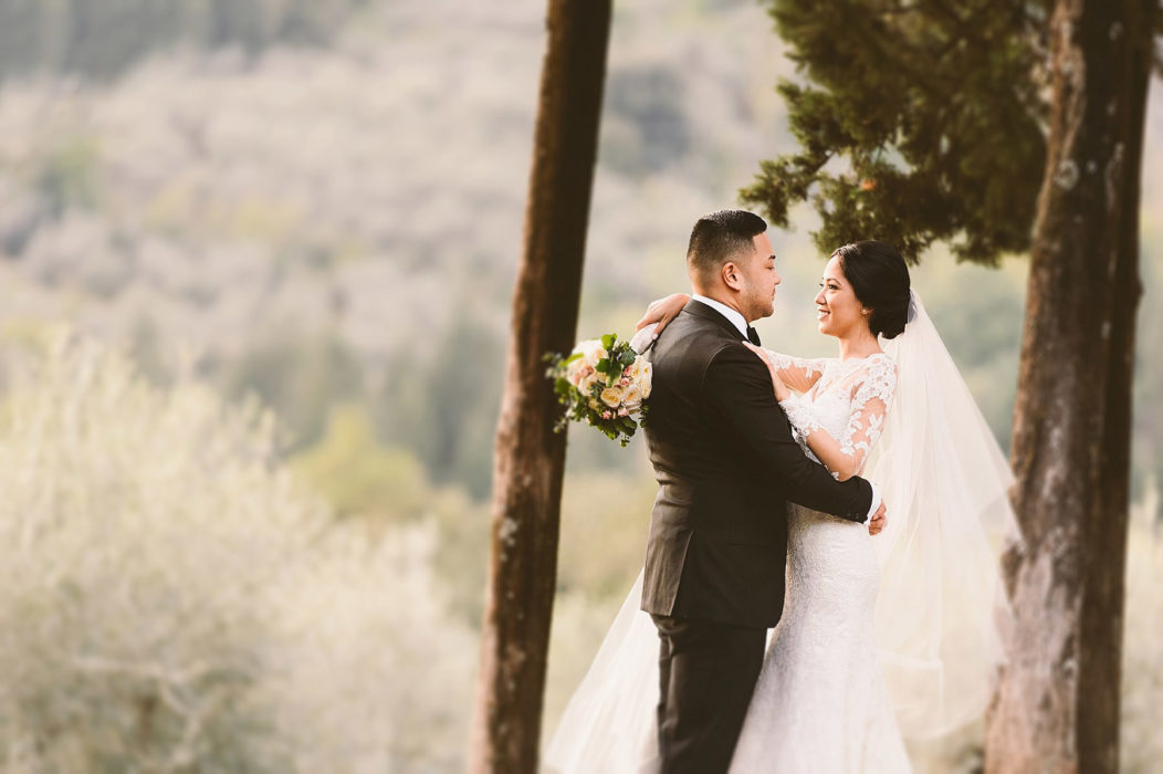 Beautiful bride groom portrait in Tuscany countryside near Vincigliata Castle. Destination wedding in Florence countryside