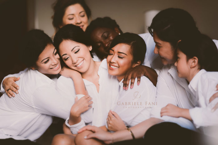 Lovely moment with bride Maria and bridesmaids during getting ready. Destination wedding in Florence countryside at Vincigliata Castle