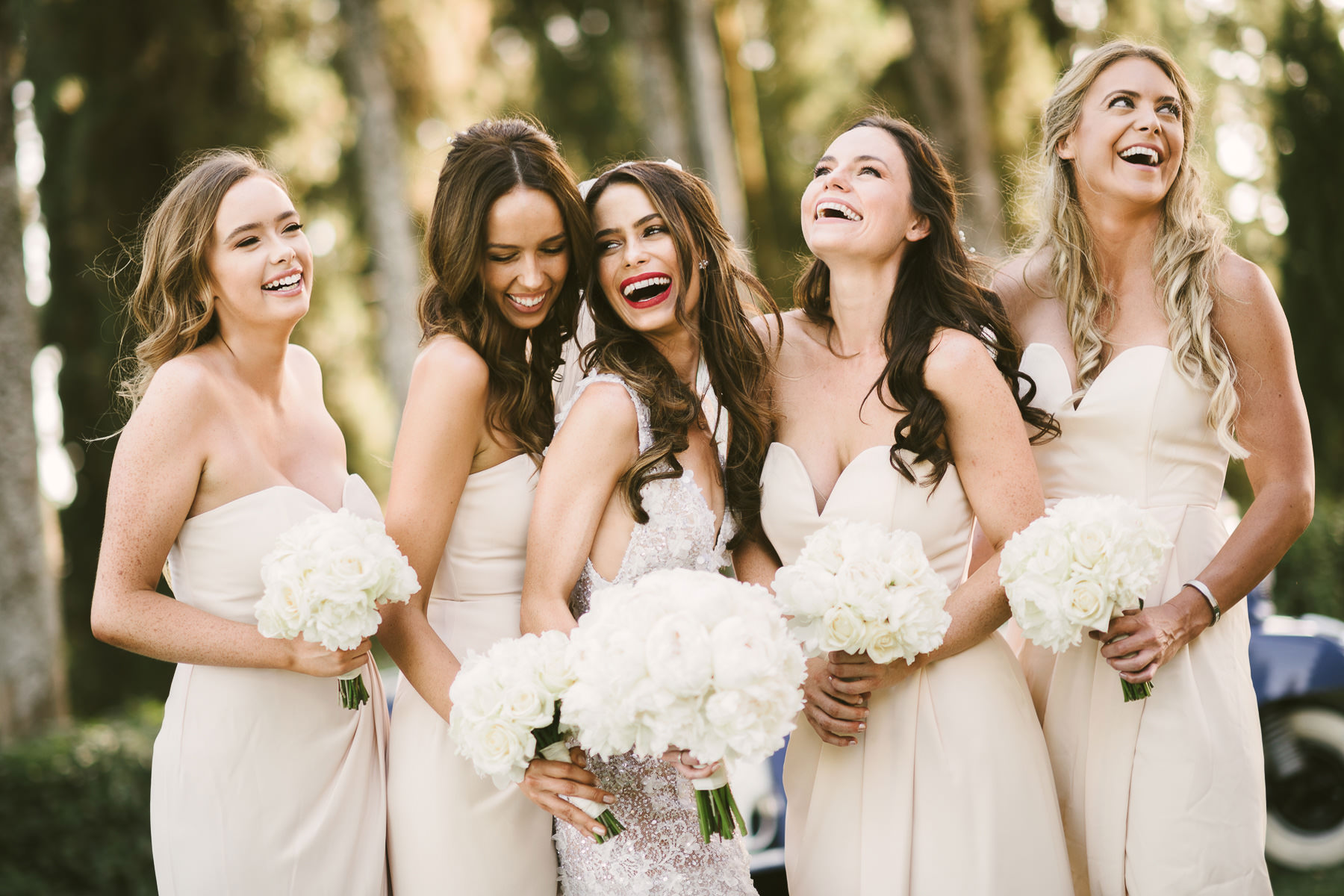 Bride Emily with lovely bridesmaids. Destination wedding in Tuscany countryside near Panzano in Chianti.
