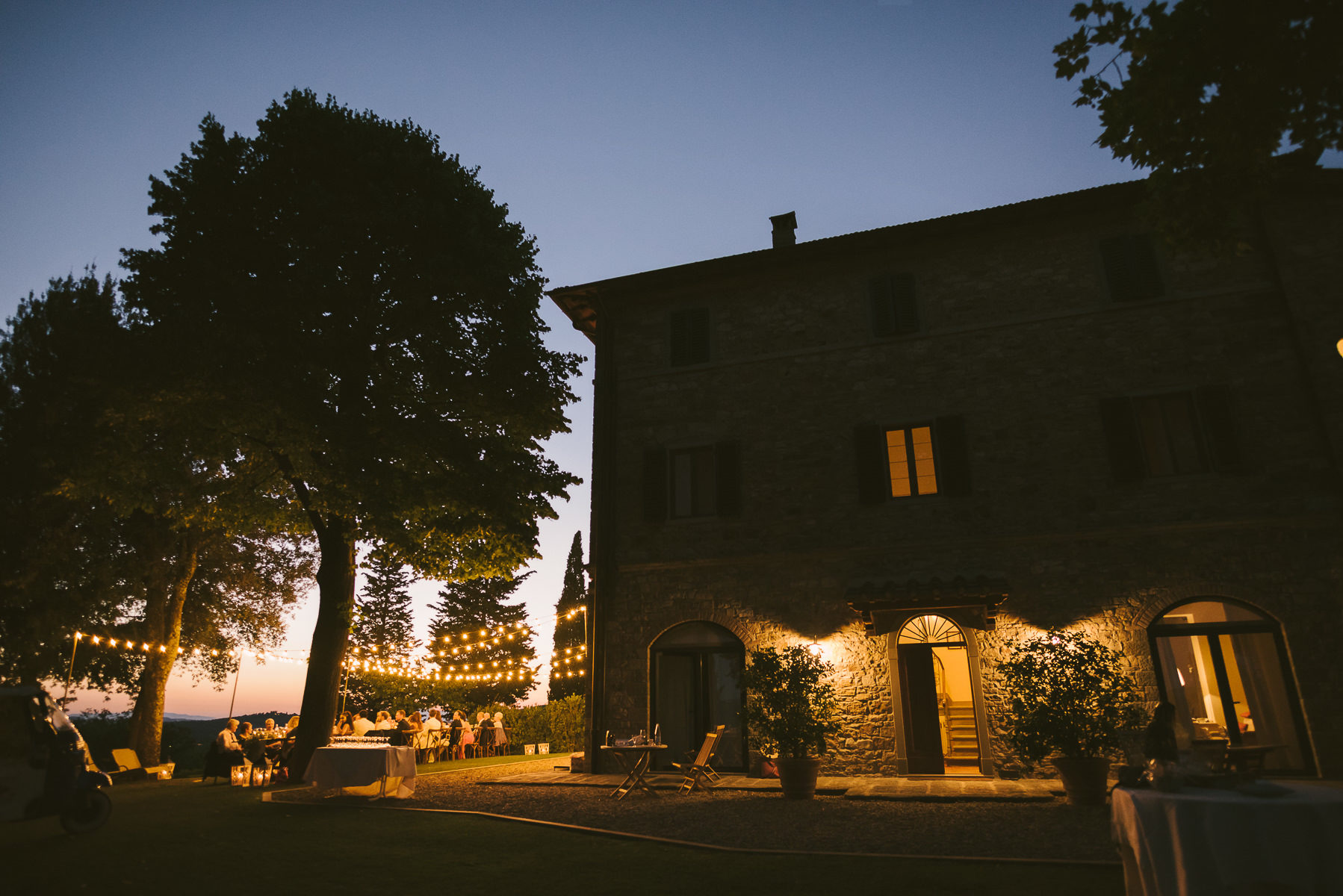 Unforgettable wedding dinner under lovely lights in Tuscany countryside in Chianti near Panzano
