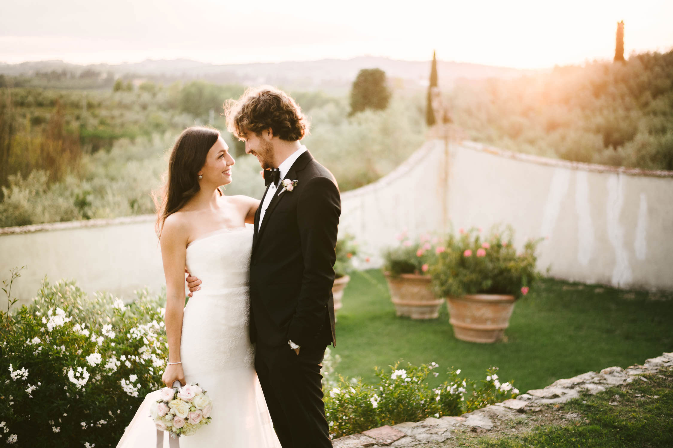 Tuscan Wedding gorgeous elegant bride in Vera Wang gown and groom wedding portrait at Villa Medicea di Lilliano Wine Estate in Florence countryside
