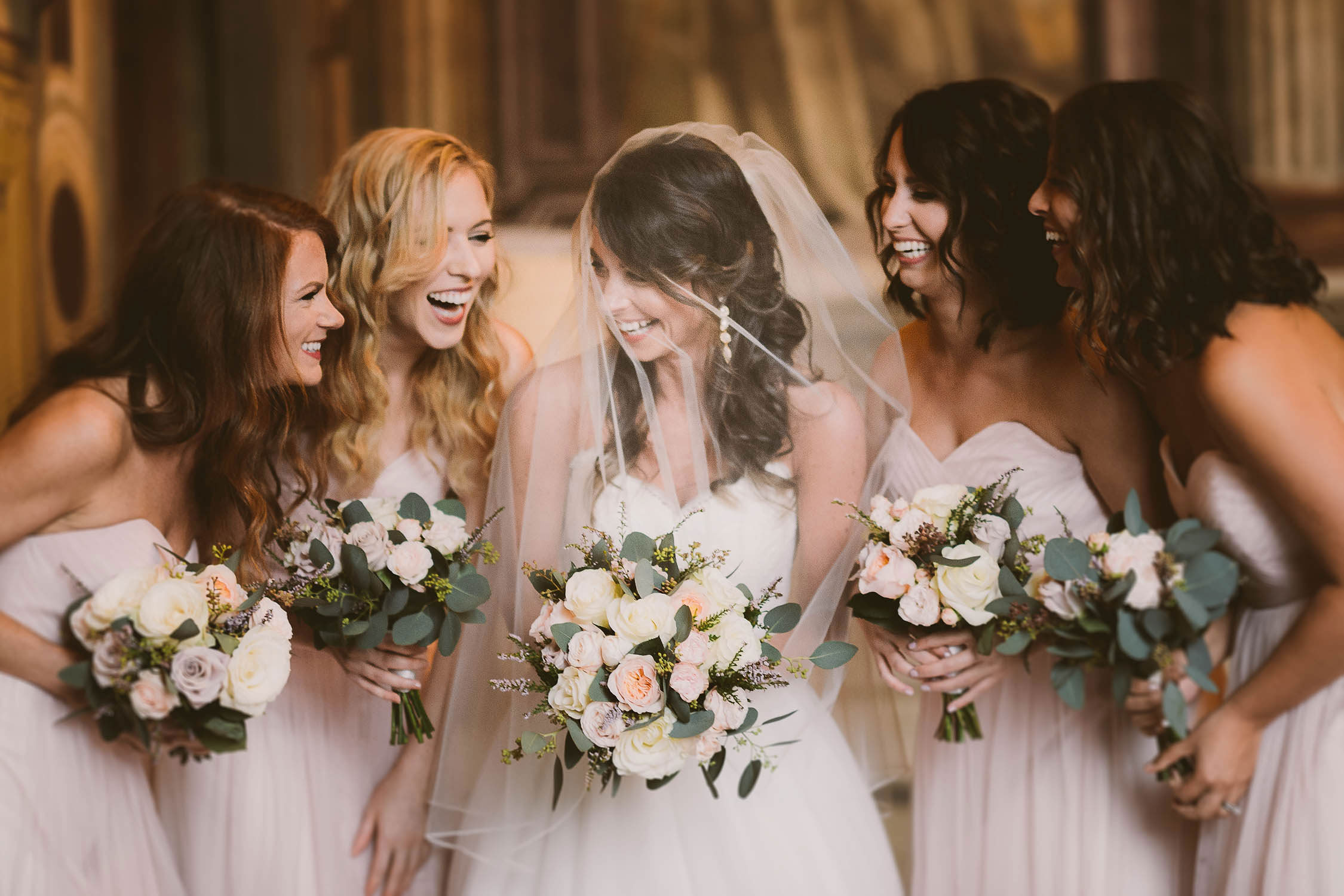 Bridal party portrait and lovely candid moment into Palazzo Pubblico in Siena for a beautiful intimate destination wedding
