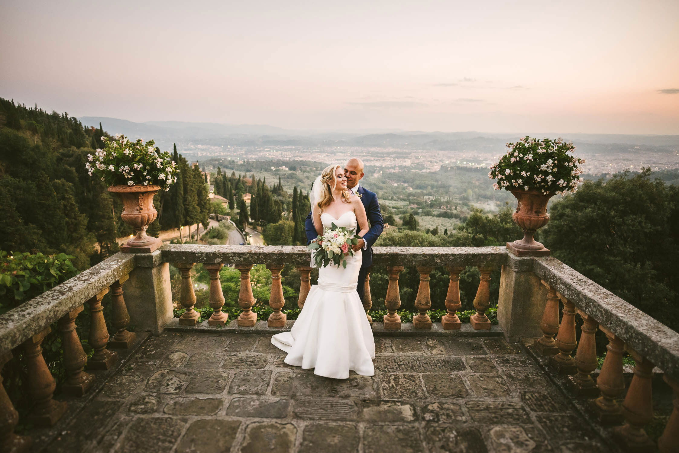 Gorgeous bride and groom share a lovely and unforgettable moment at Belmond Villa San Michele luxury venue near Florence