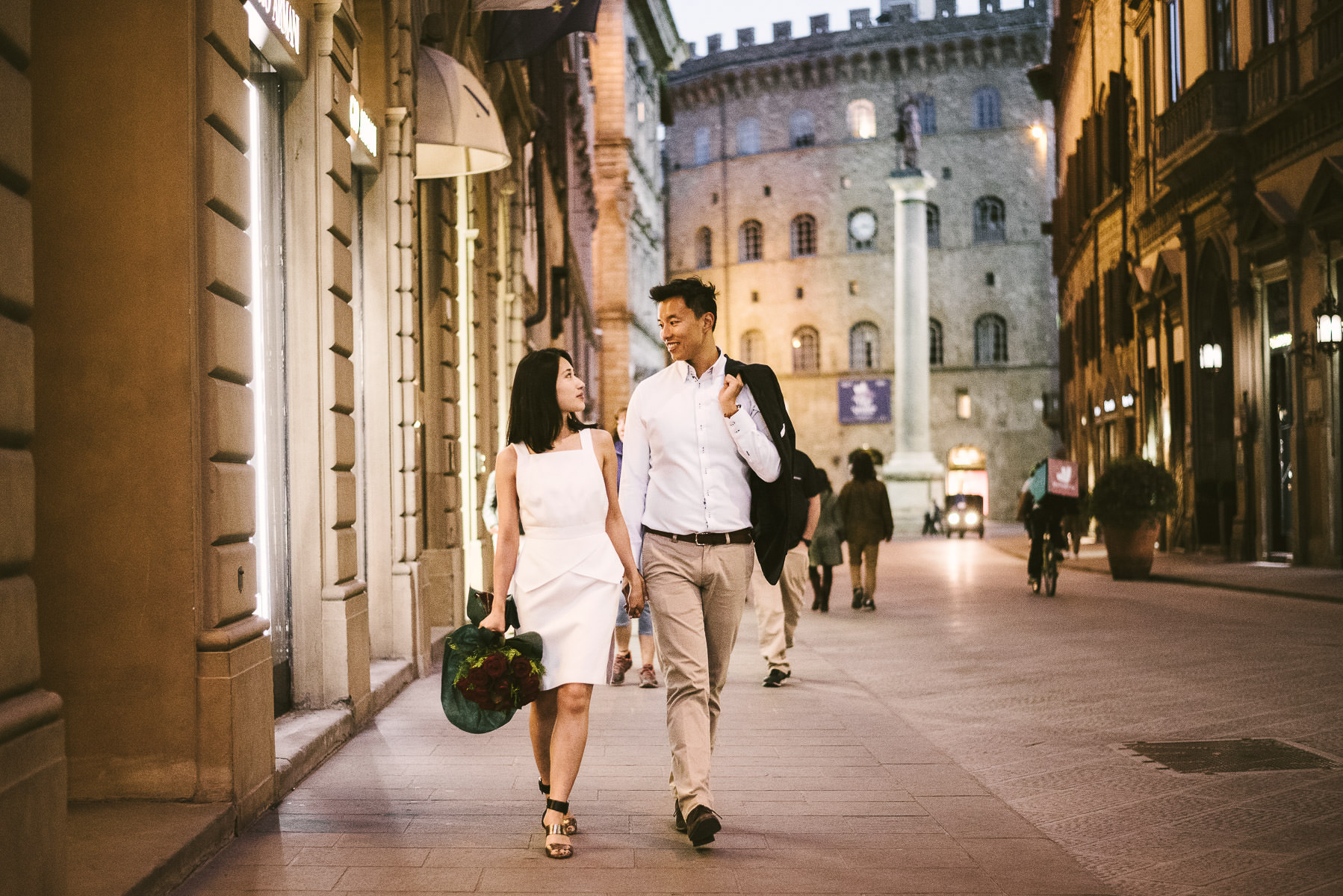 Candid and romantic engagement pre wedding photo shoot into the streets of Florence