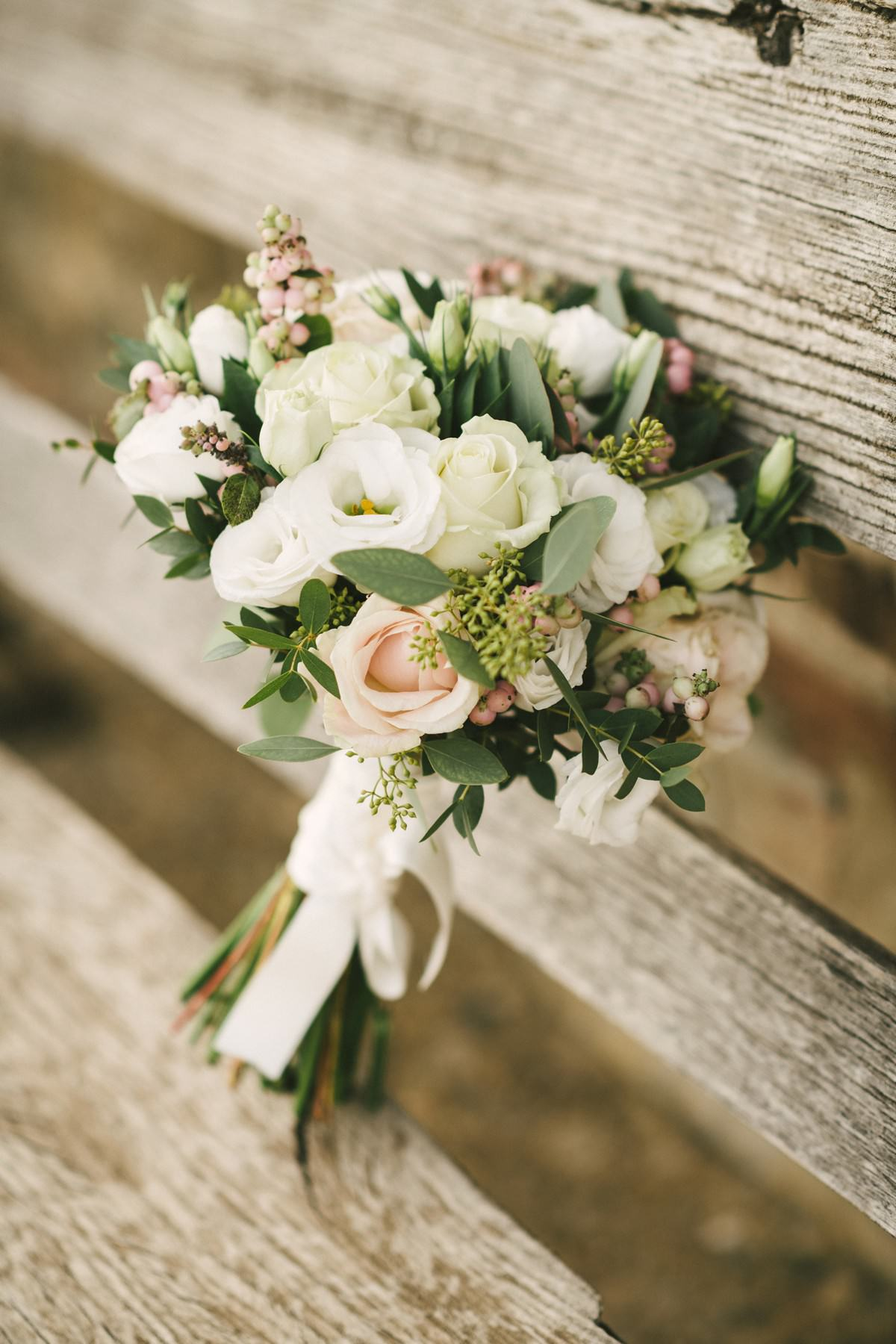 Lovely bride bouquet with green white and roses colours. Intimate and romantic elopement in Tuscany