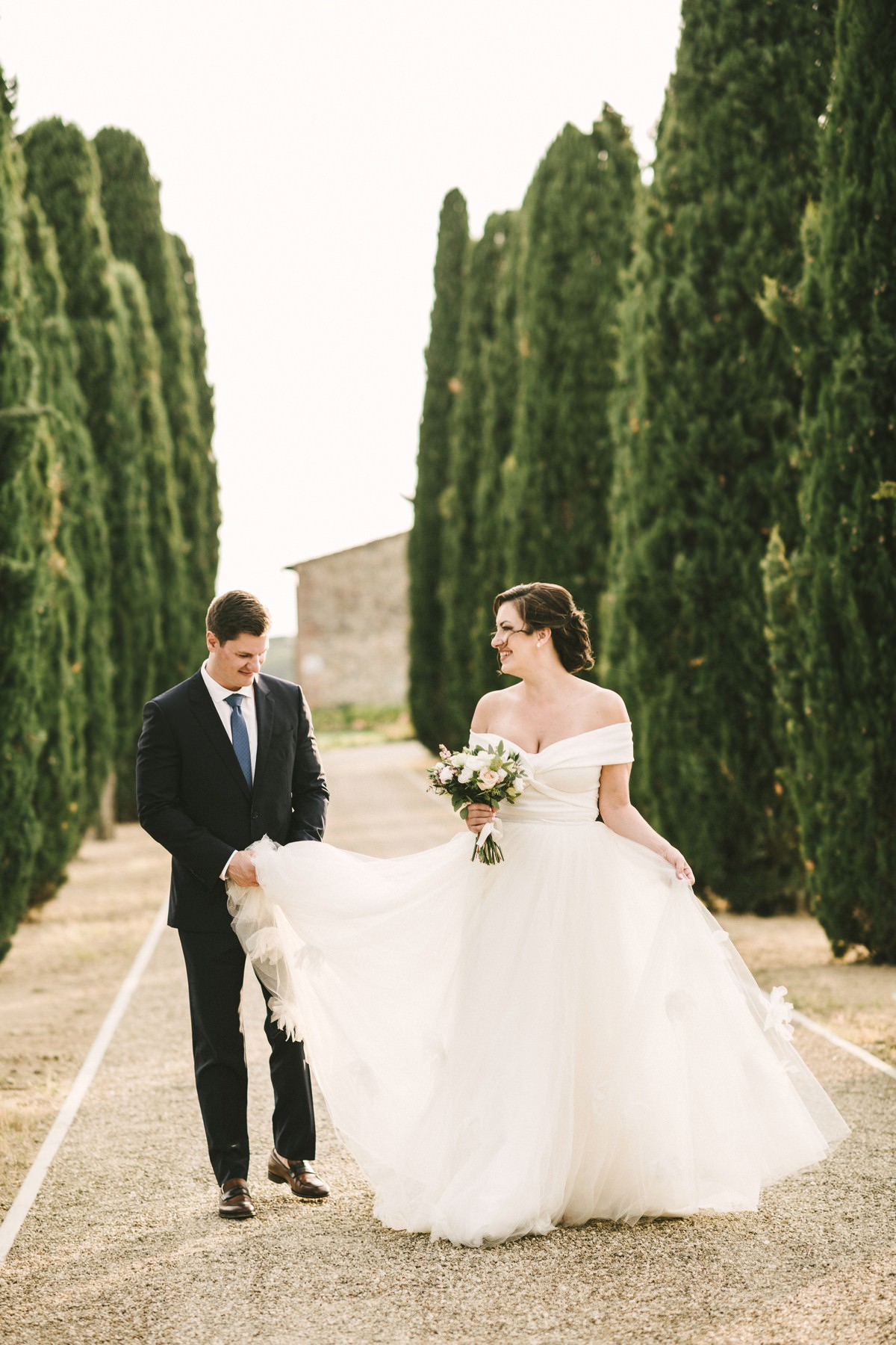 Dreamy couple portraits in the evocative cypress boulevard at farmhouse Casetta