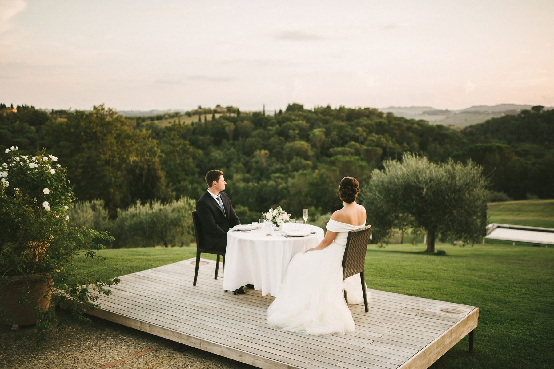 Dreamy couple portraits at the charming dinner setting. Elopement wedding in Tuscany countryside farmhouse Casetta