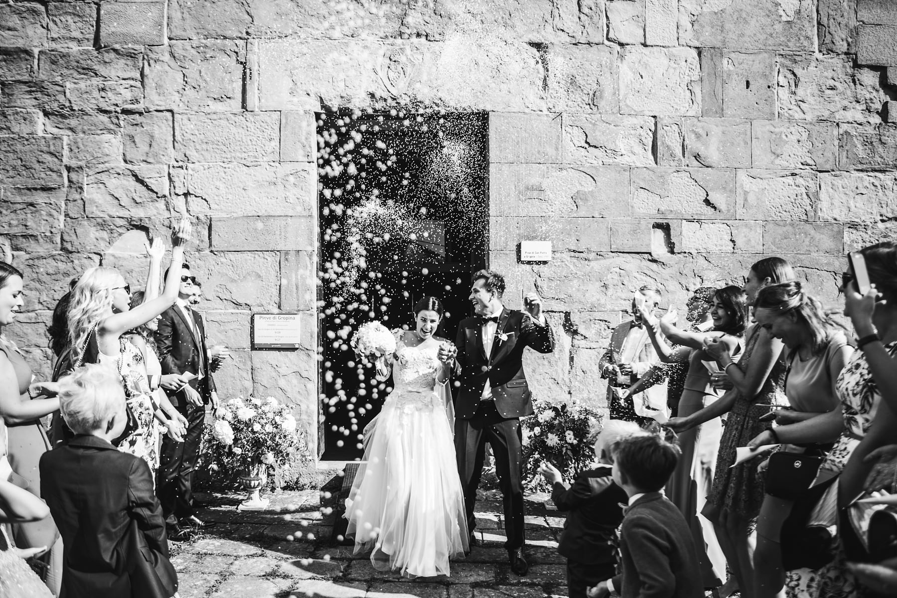 Exciting petal throwing for bride and groom at Pieve di Gropina