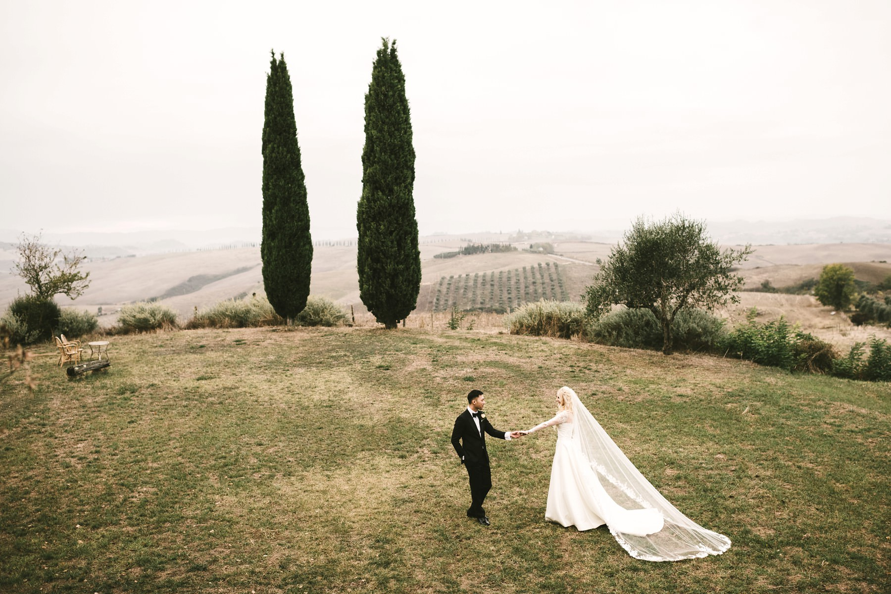 Elegant bride and groom portrait in Tuscany countryside Val D'Orcia at La Fornace