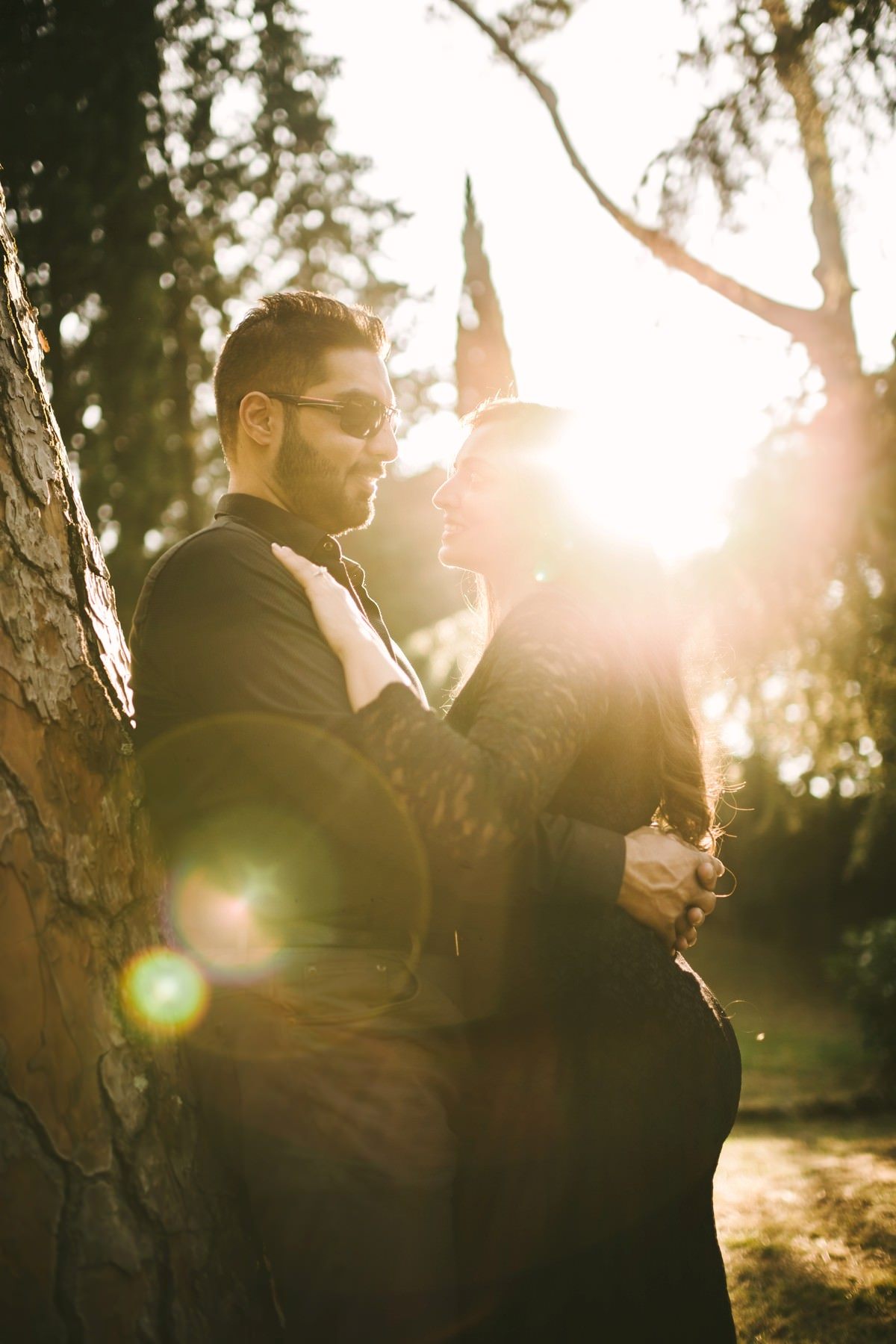 Couple engaged under the lovely Tuscan sun in the countryside of Florence