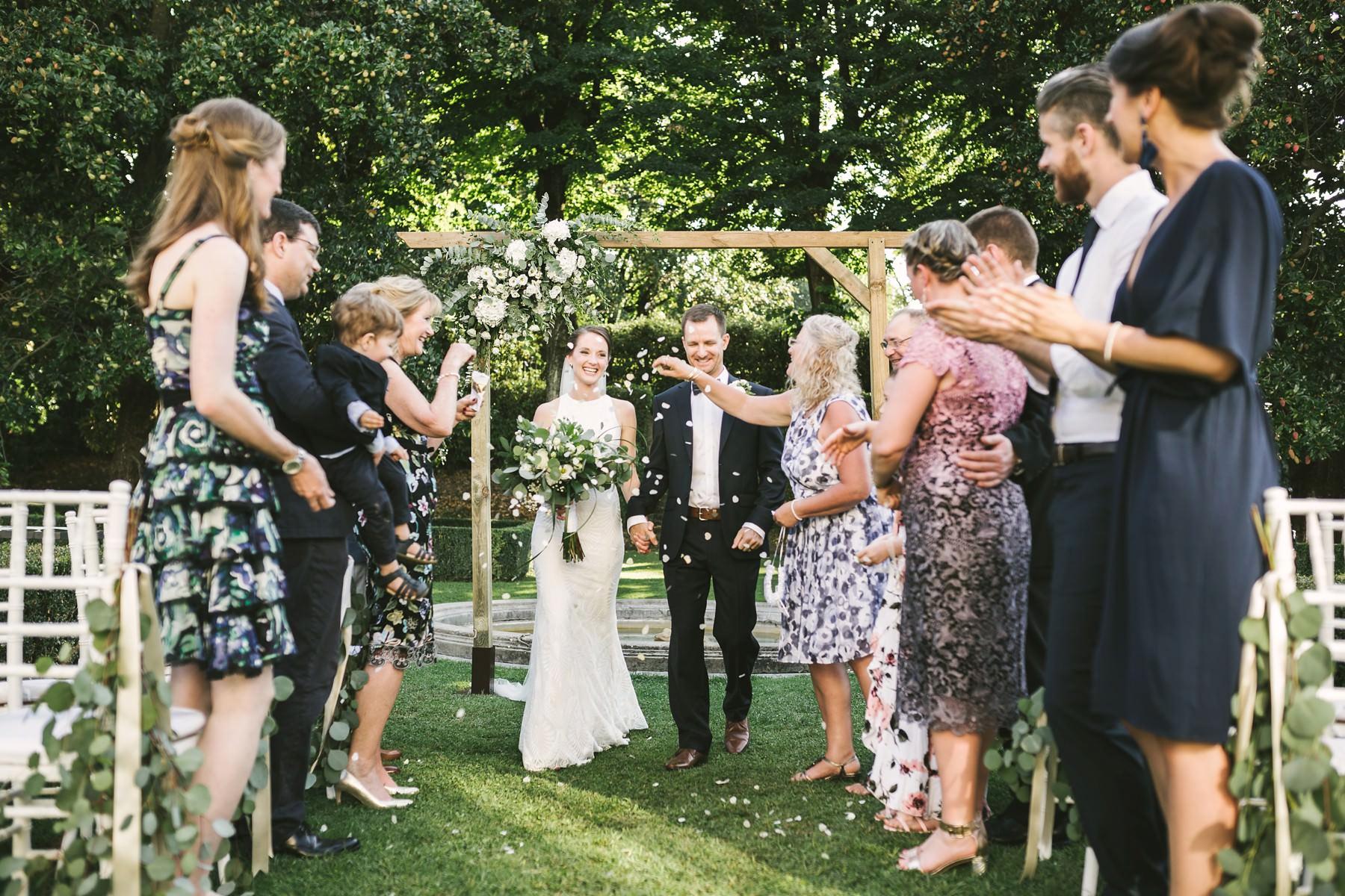 Bride and groom petal throwing destination wedding in Florence