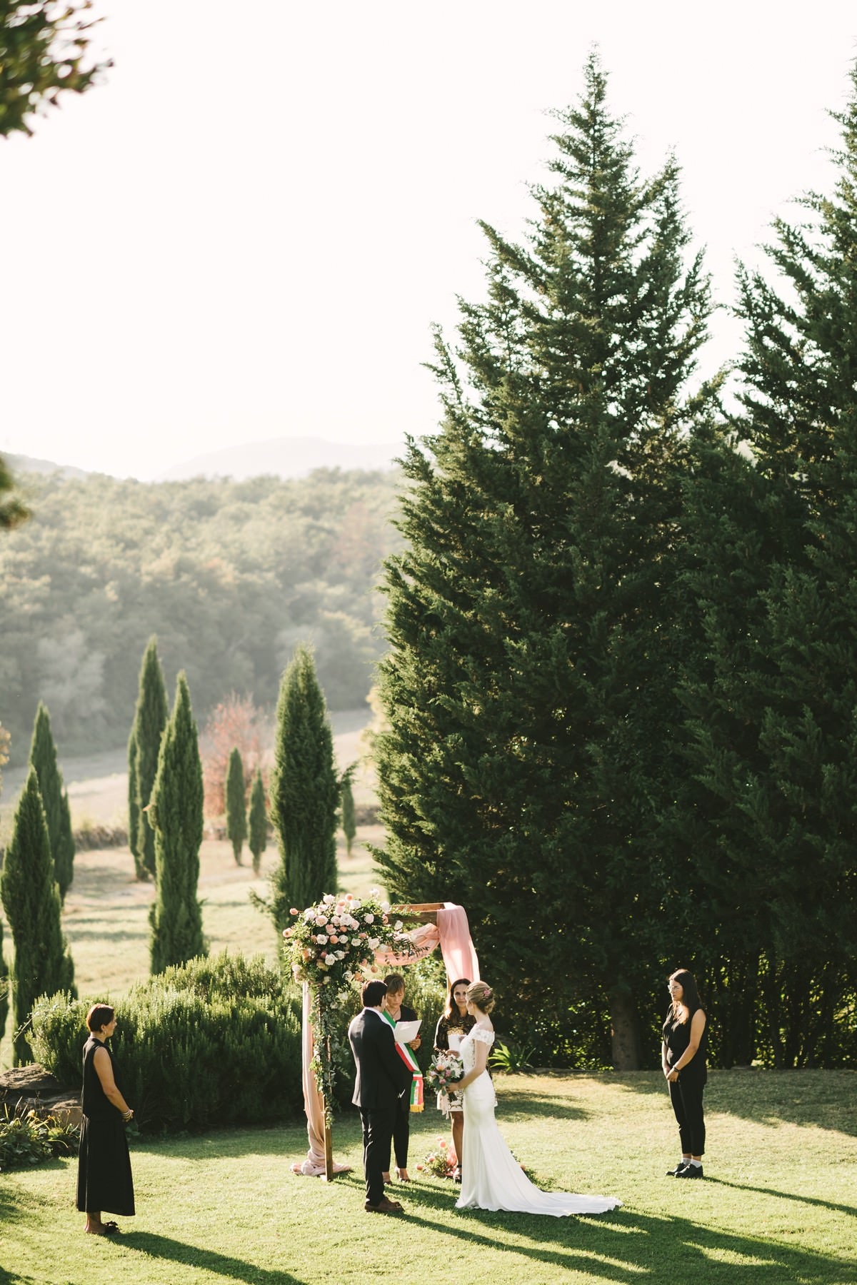 Evocative outdoor elopement wedding civil ceremony in Tuscany countryside Villa La Selva Wine Resort
