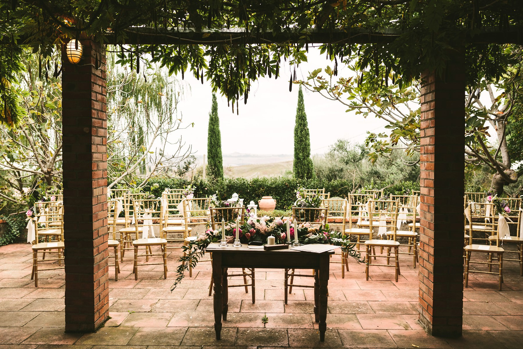 Elegant outdoor ceremony decor for destination wedding in Val D'Orcia