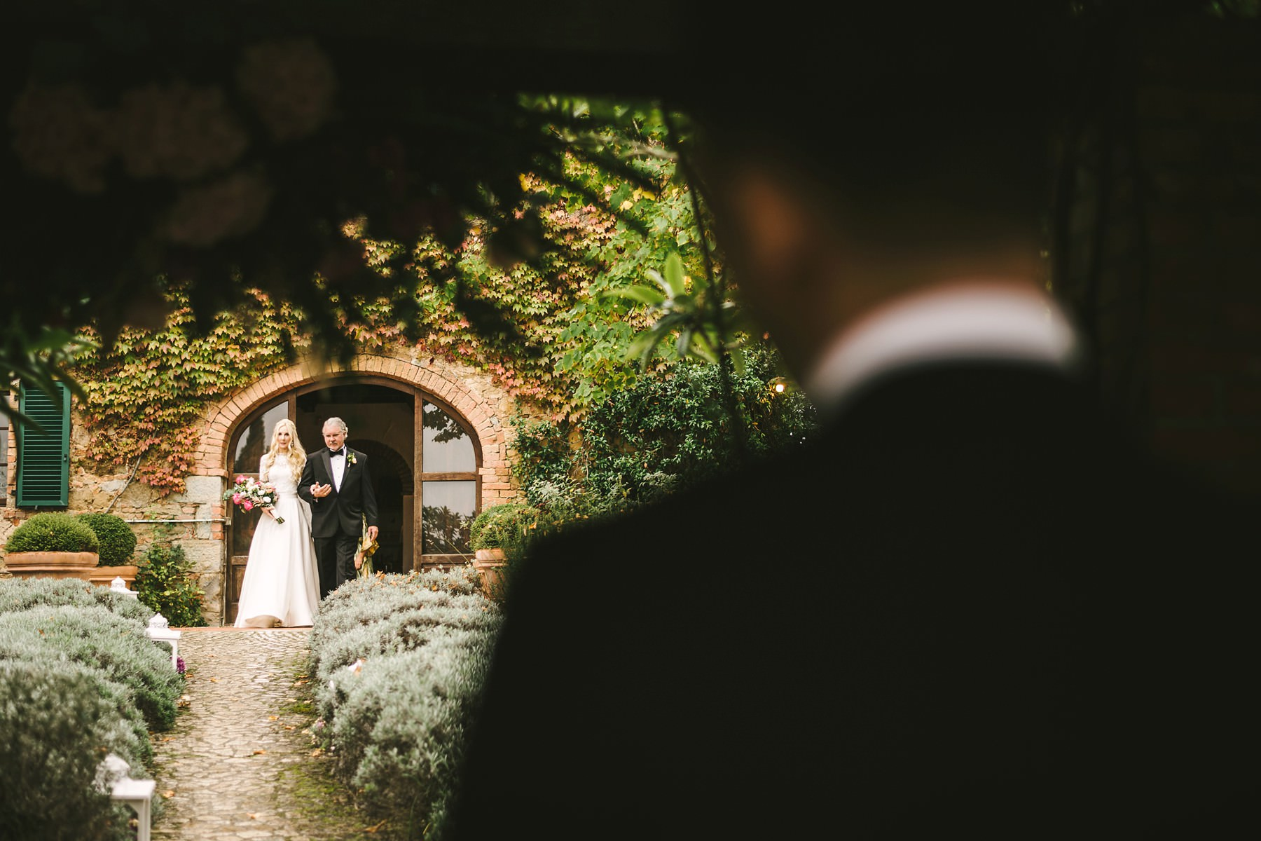 Bride and groom first look during outdoor ceremony in Tuscany