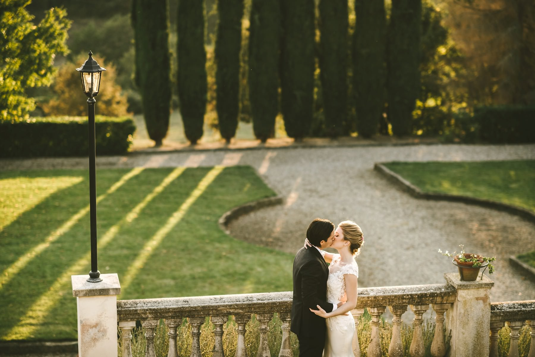 Bride and groom wedding portrait with cypress at Villa La Selva in the countryside of Tuscany