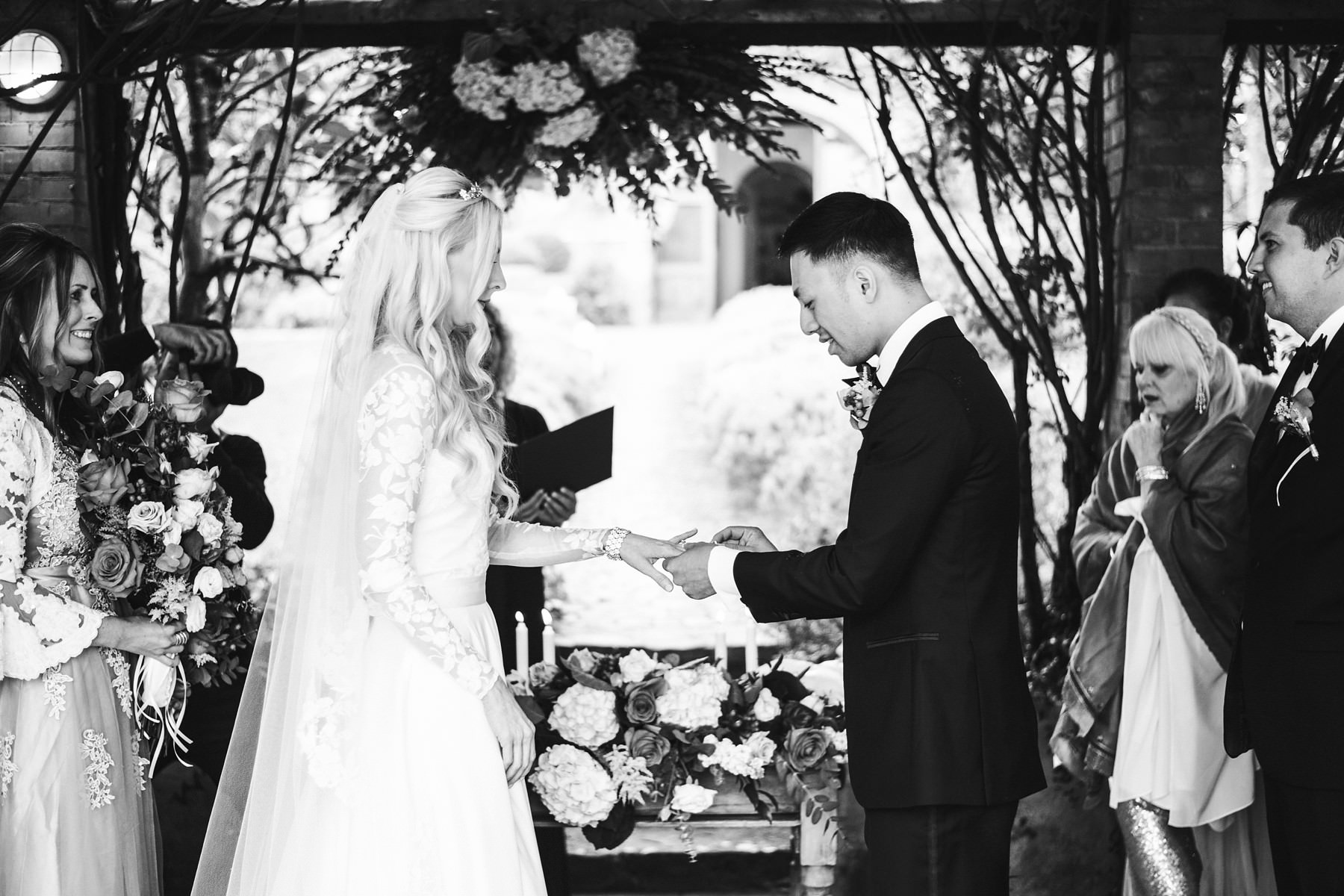 Bride and groom exchanging of the rings. Intimate outdoor ceremony at La Fornace, Tuscany