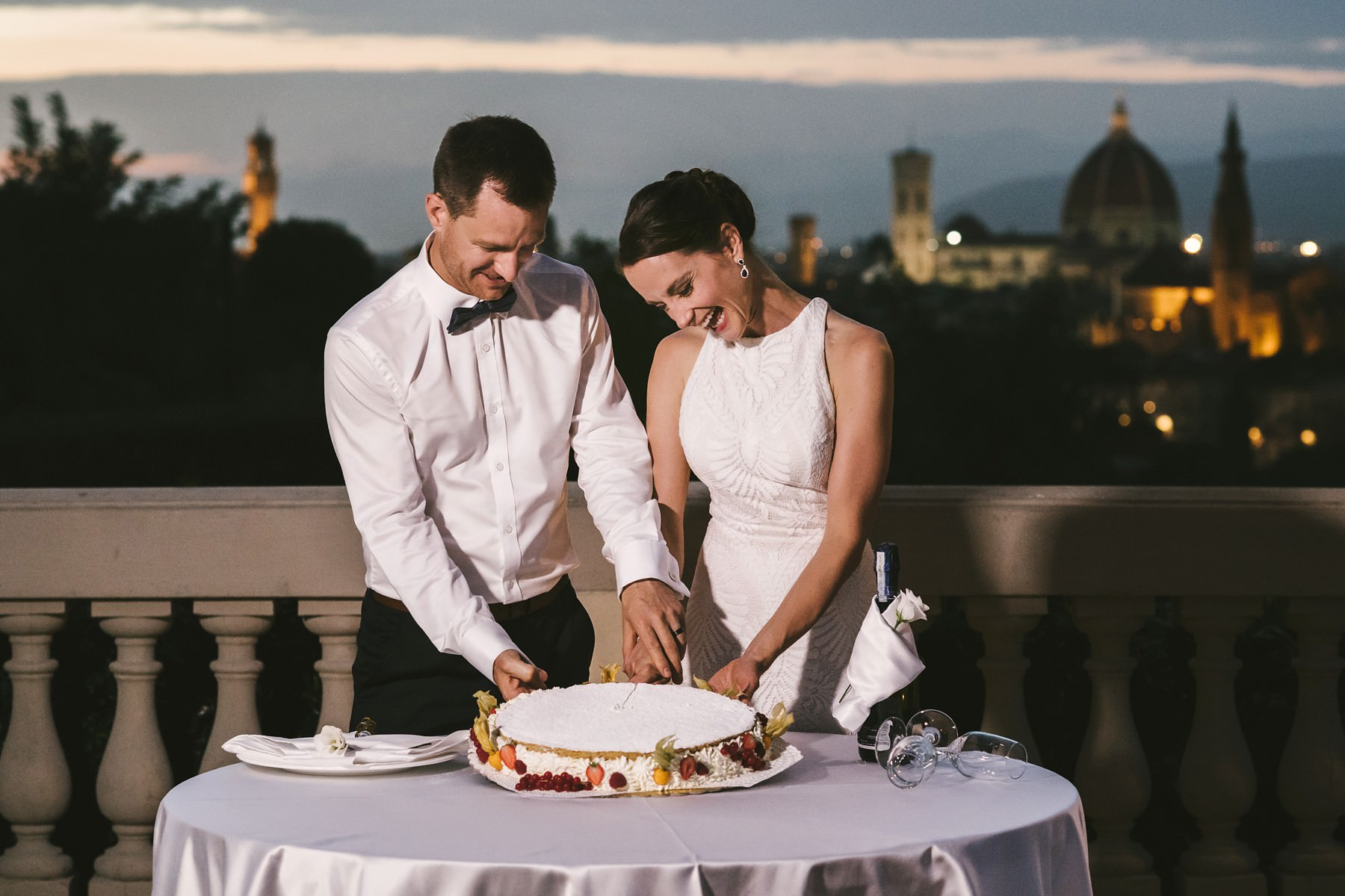 Cake cut with Florence Dome in the background at Villa La Vedetta