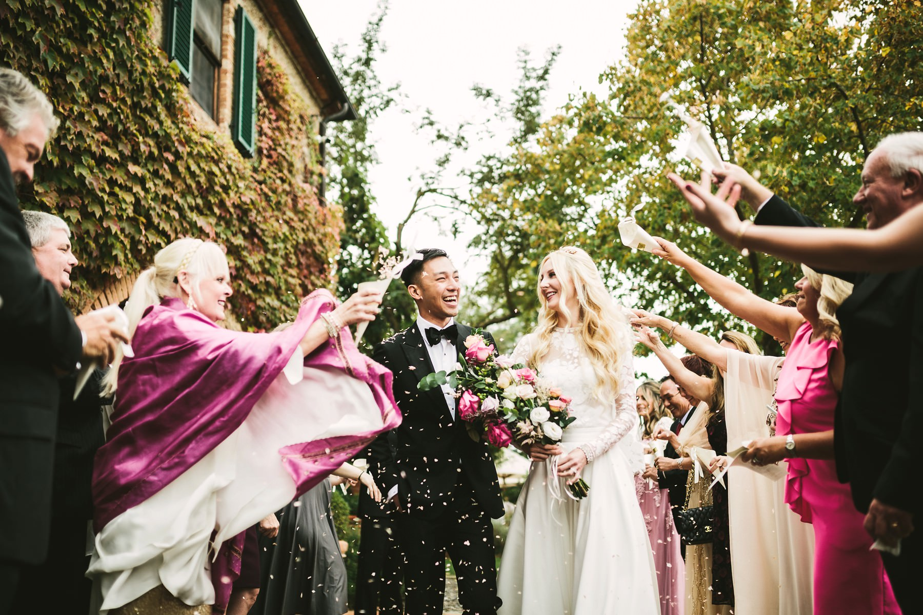 Lovely candid shoot during wedding petal throwing