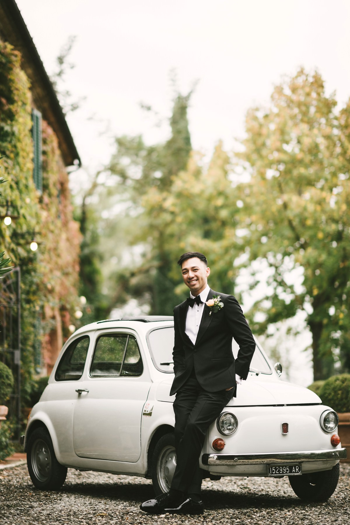 Elegant groom Huy with Fiat 500 in La Fornace wedding venue a perfect location to get married in Italy