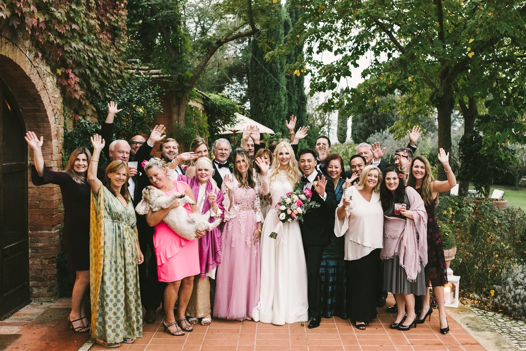 Group photo with bride and groom. Intimate destination wedding in Tuscany