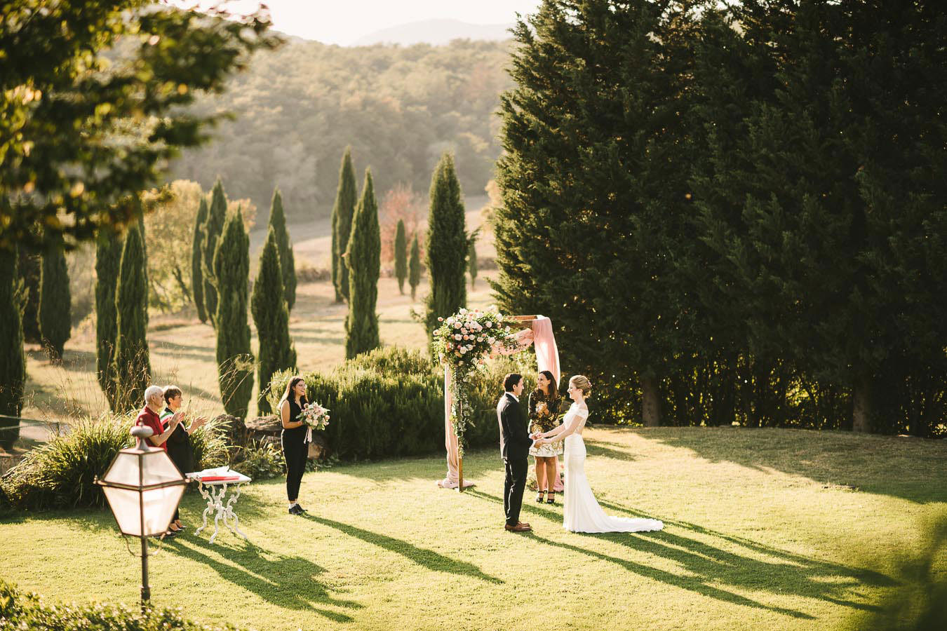 Bride and groom emotional exchange of the vows. Intimate elopement wedding at Villa La Selva resort in the countryside of Tuscany