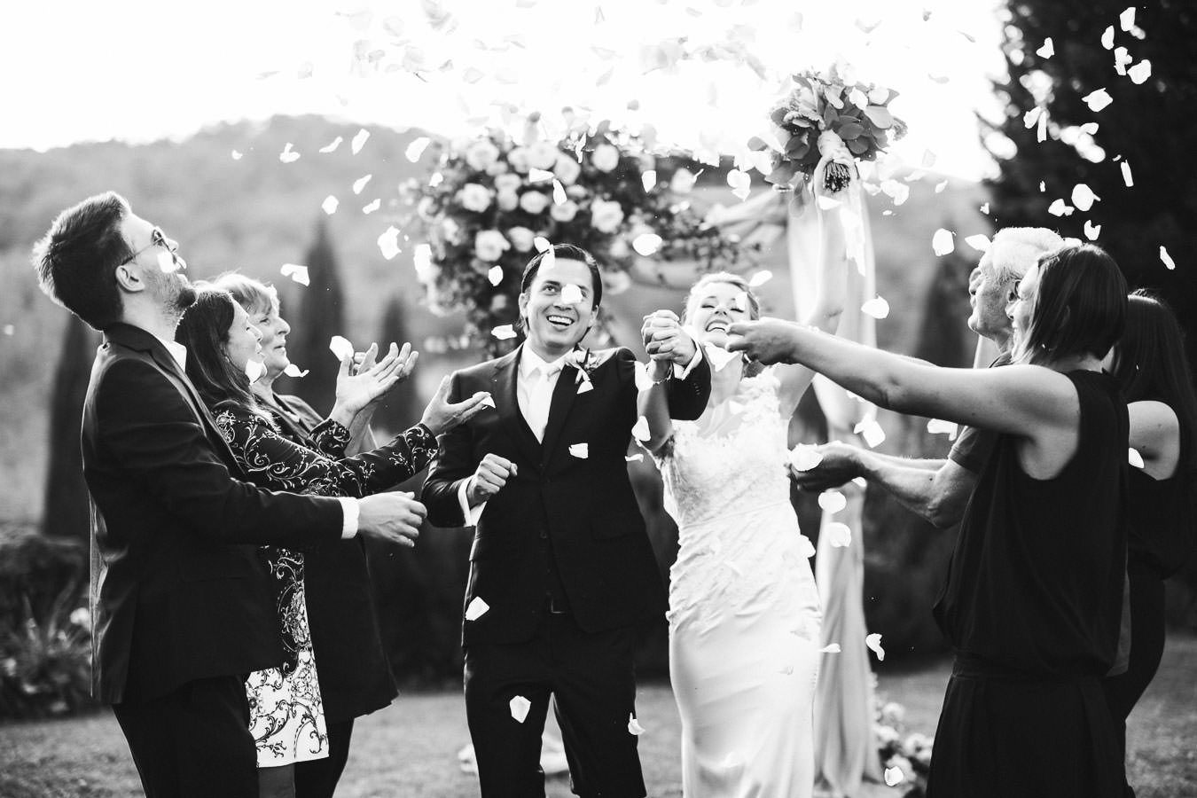 Exciting moment during petal throw for Bride Shauna in Kelly Faetanini wedding gown and groom Luis Enrique