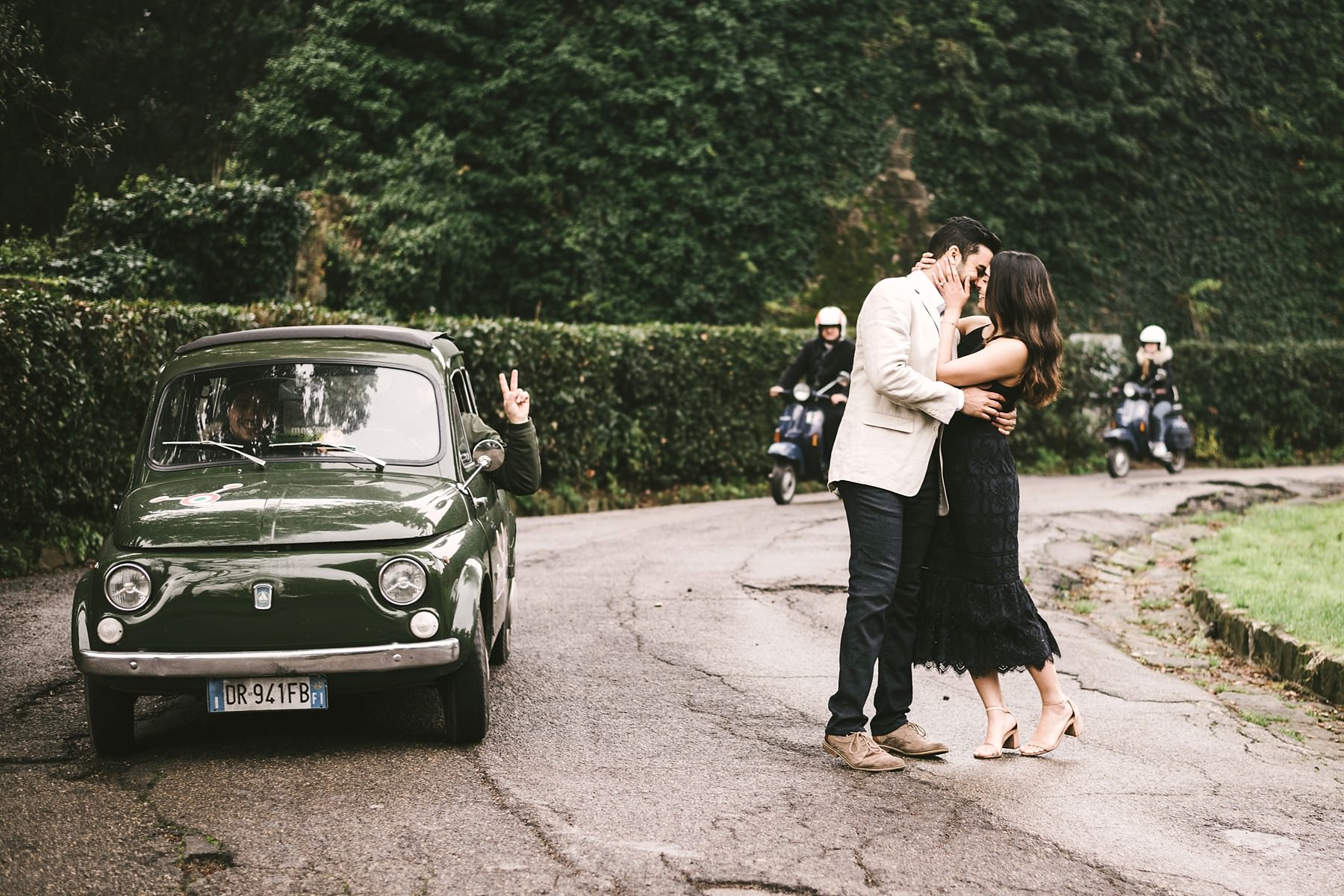 Couple in love with fiat 500 and vespa riders for a typically Italian style photo shoot