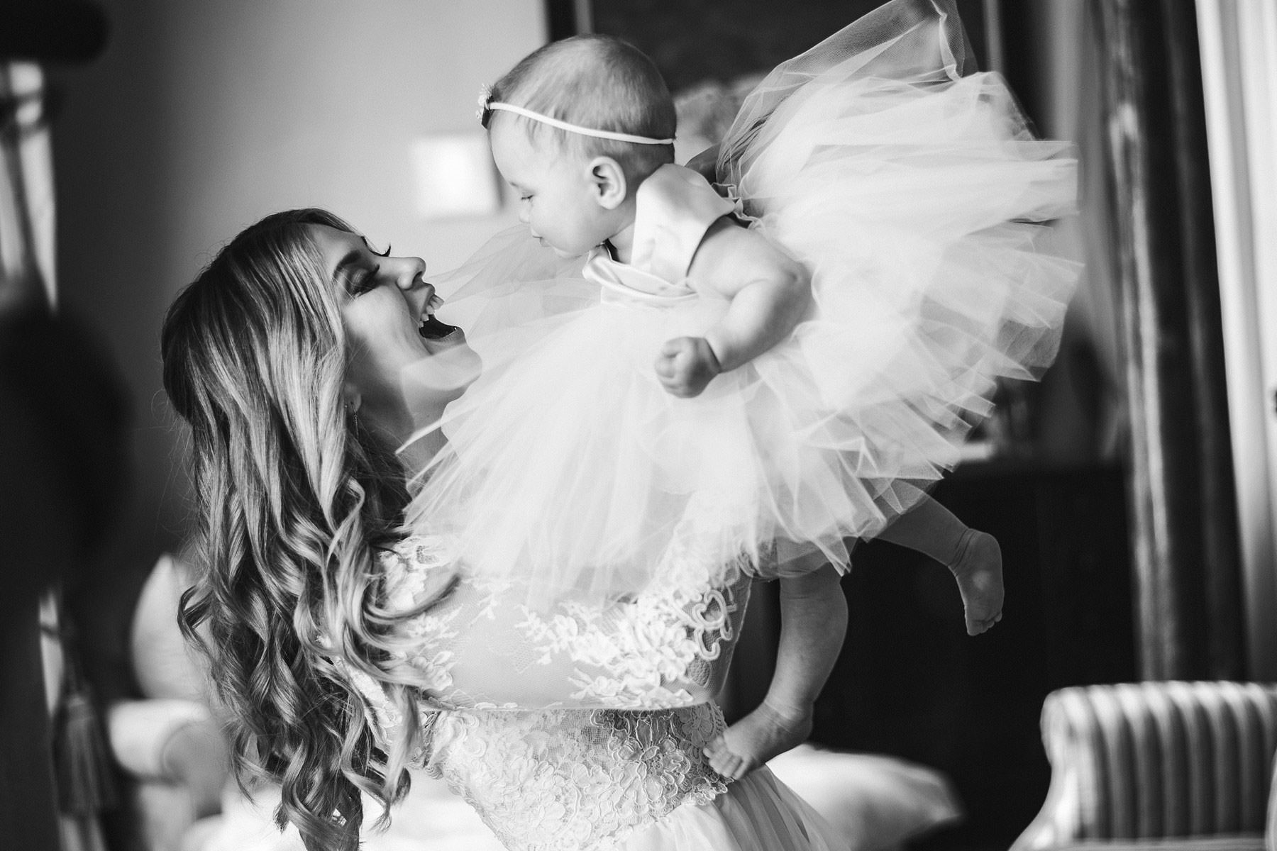 Lovely moment of the bride Cecily and her daughter during getting ready phase at Villa Mangiacane in Tuscany