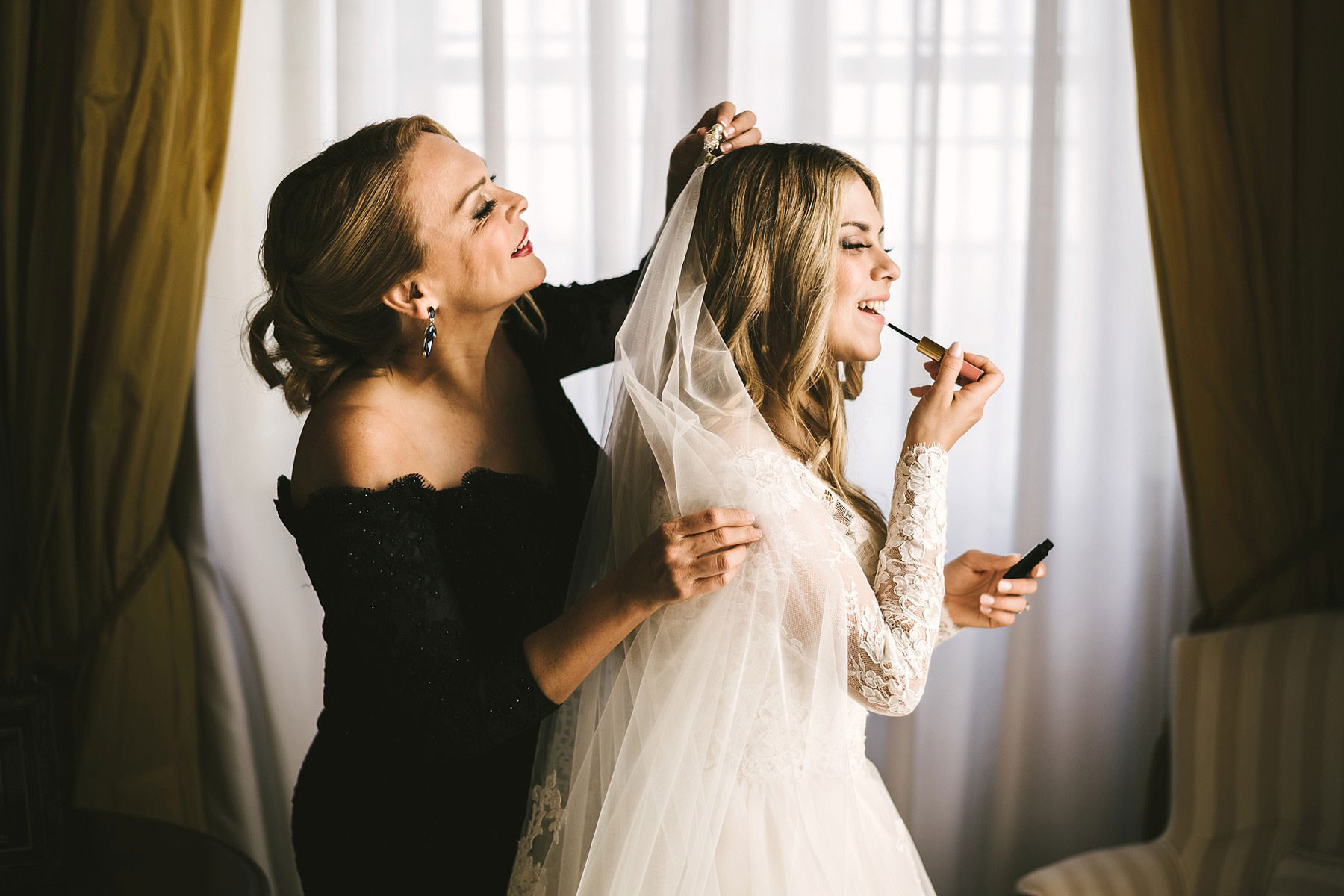Mom and bride just get ready for the wedding ceremony. Destination wedding in Italy at Villa Mangiacane