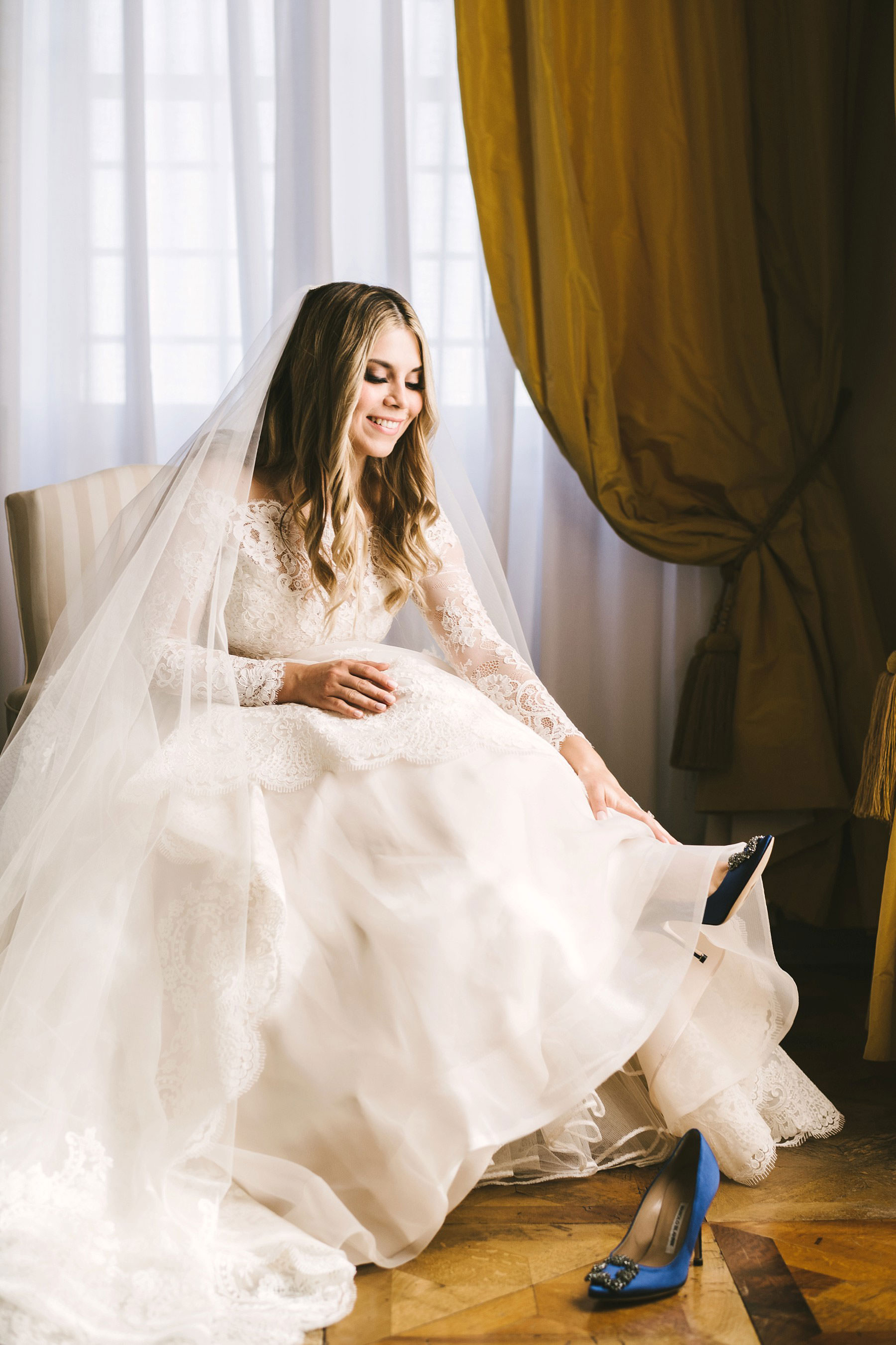 Lovely and beautiful bride Cecily wear her wedding shoes by Manolo Blahnik