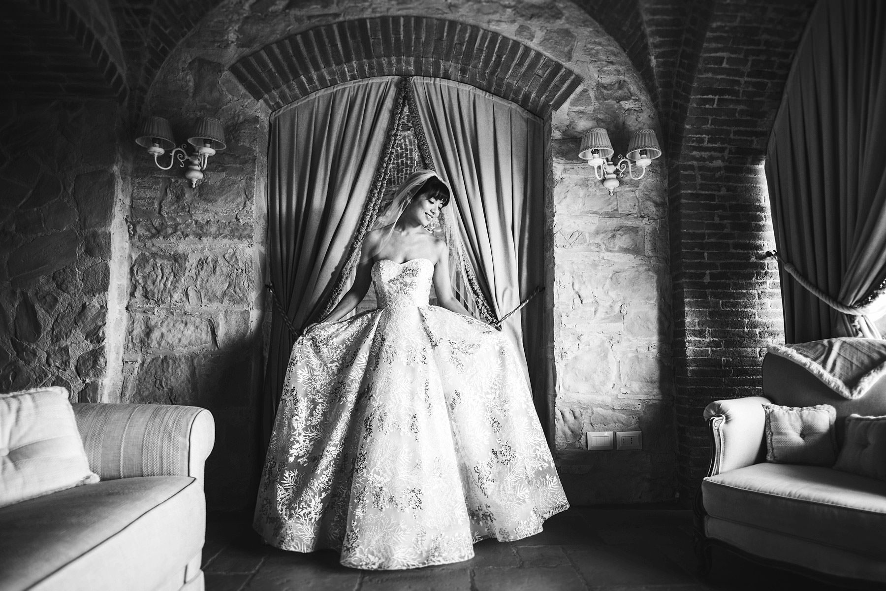 Beautiful bride Elizabeth is almost ready to leave Villa Le Fontanelle venue for the ceremony in Florence church