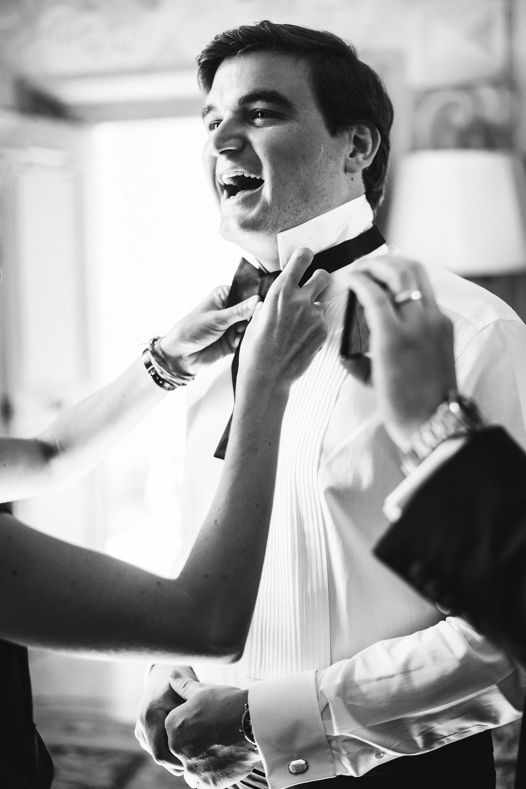 Lovely candid photo of the groom during getting ready at Villa Mangiacane, Tuscany