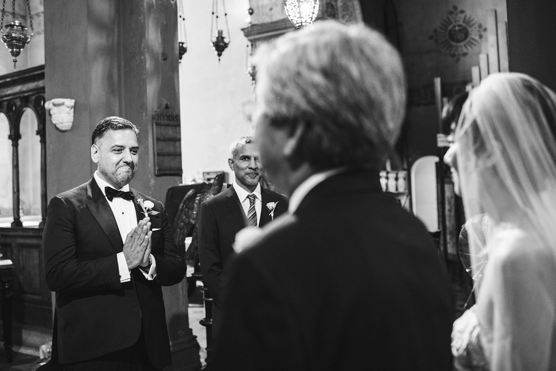 Unforgettable and beautiful groom's first look reaction in St. Mark Church in the heart of Florence. Intimate destination wedding