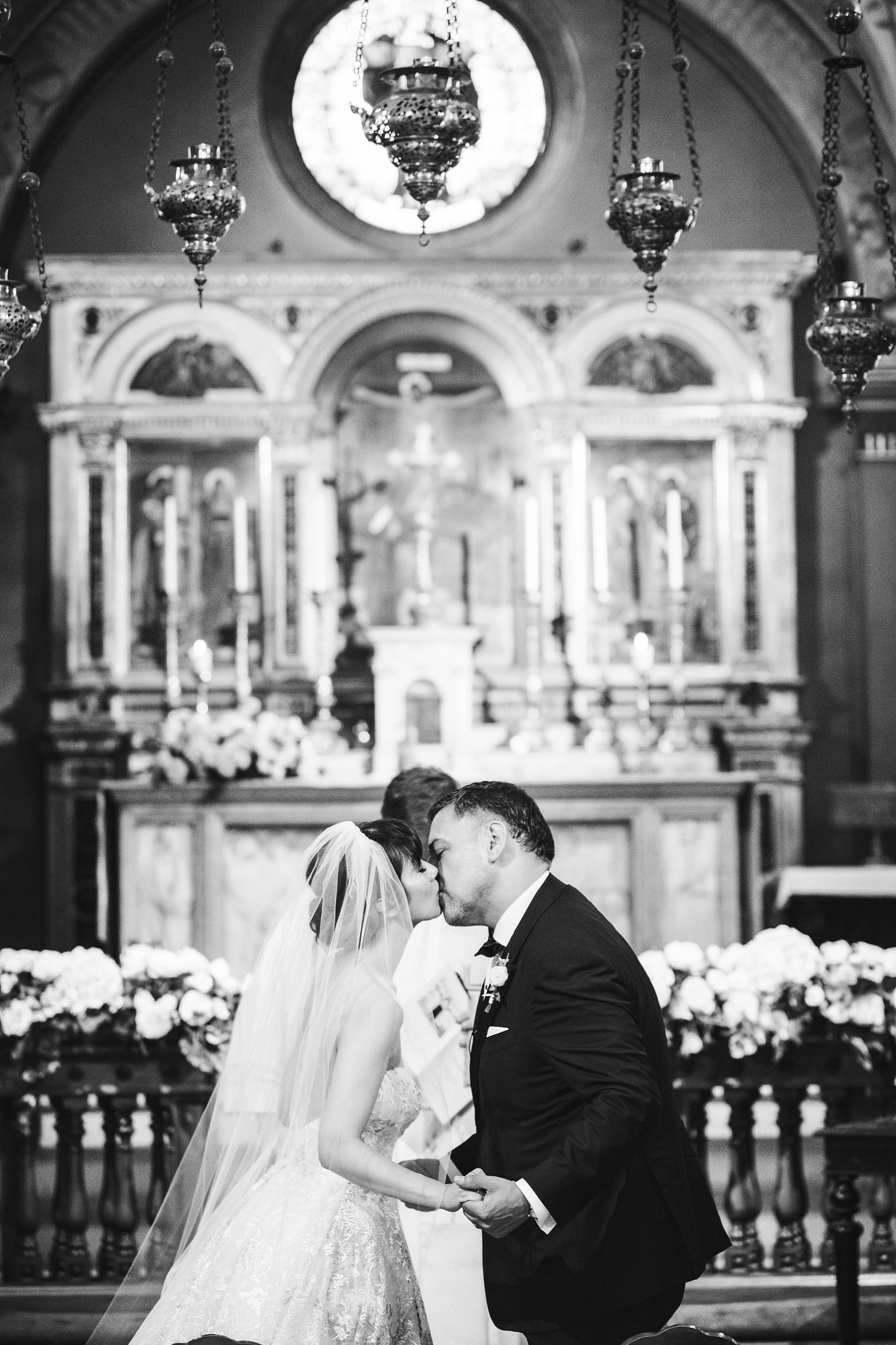 Bride and groom first kiss in St. Mark Church in the heart of Florence. Intimate destination wedding with reception at Villa Le Fontanelle