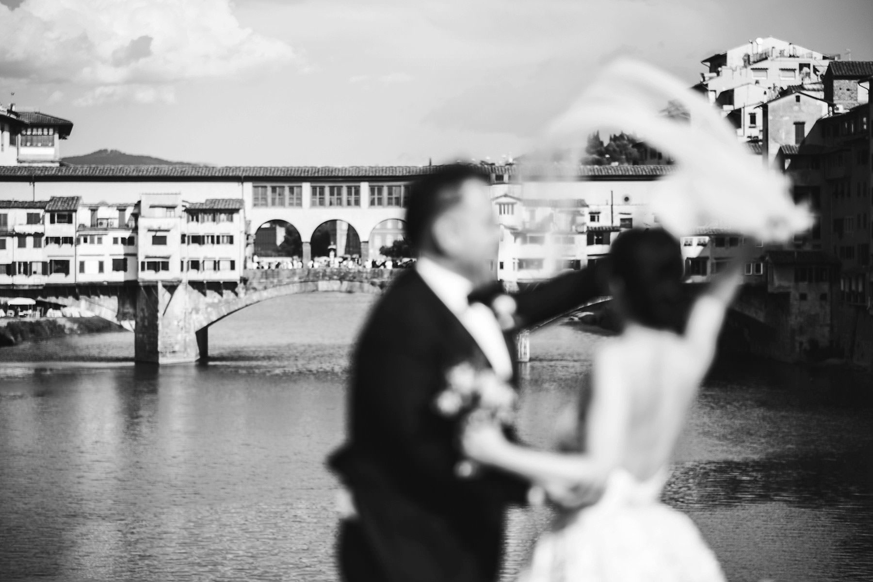 Gorgeous candid moment fro bride and groom near Ponte Vecchio in Florence