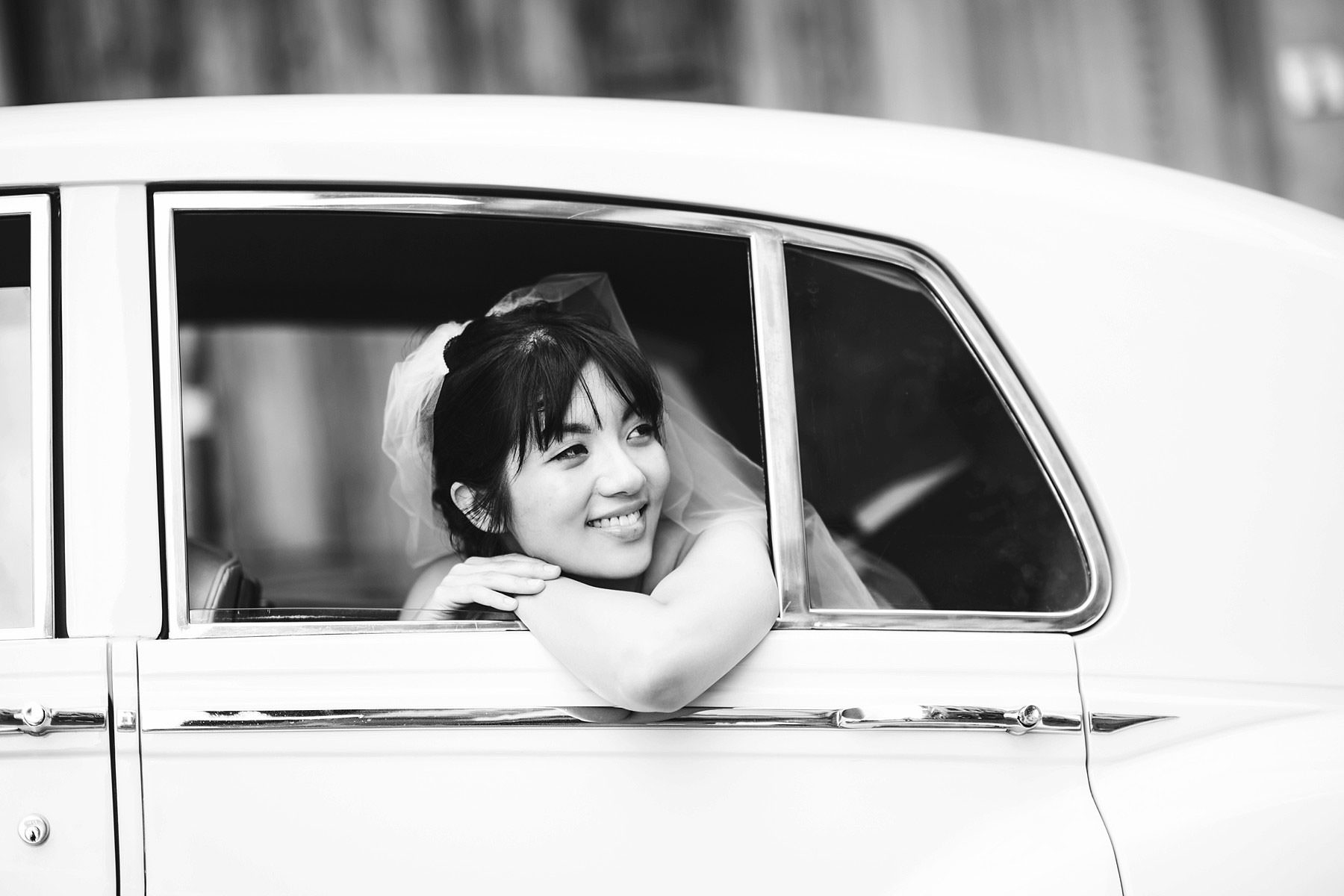 Lovely bride Elizabeth in her Rolls Royce. Intimate and elegant destination wedding in Florence at Villa Le Fontanelle