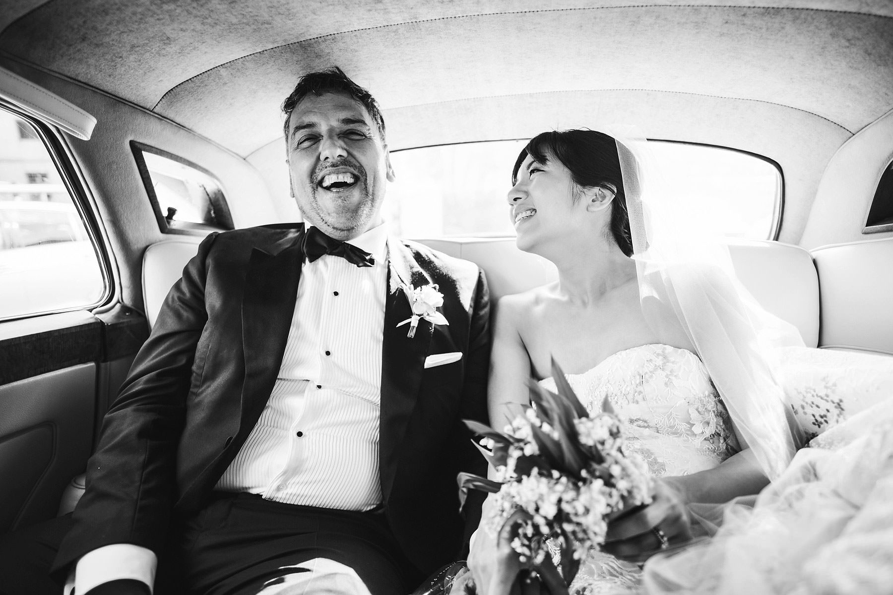 Enjoy the love. Bride and groom candid photo during transportation to the wedding venue Villa Le Fontanelle. Intimate and elegant destination wedding in Florence