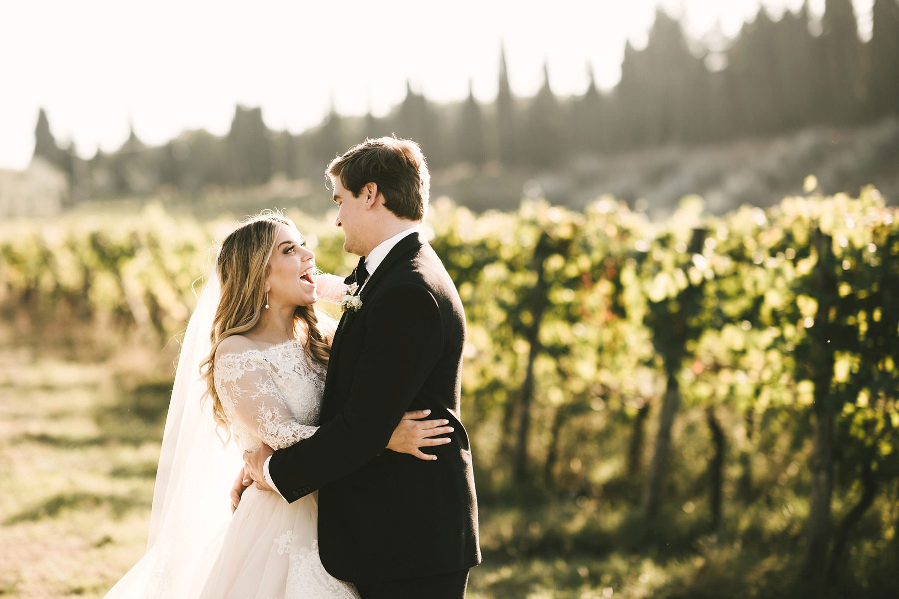Beautiful wedding couple portrait under the Tuscan sun and near a typical Chianti vineyard. Intimate destination wedding in Tuscany at Villa Mangiacane