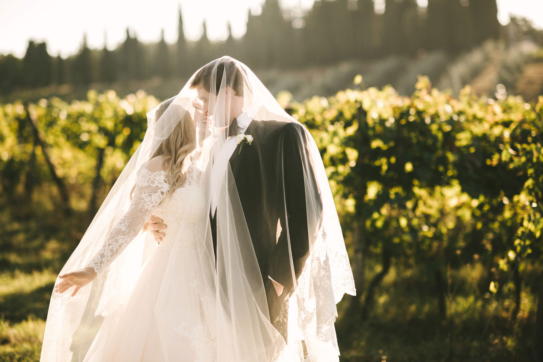 Lovely moment and wedding bride and groom portrait in Tuscany vineyard near Villa Mangiacane, Chianti. Intimate destination wedding