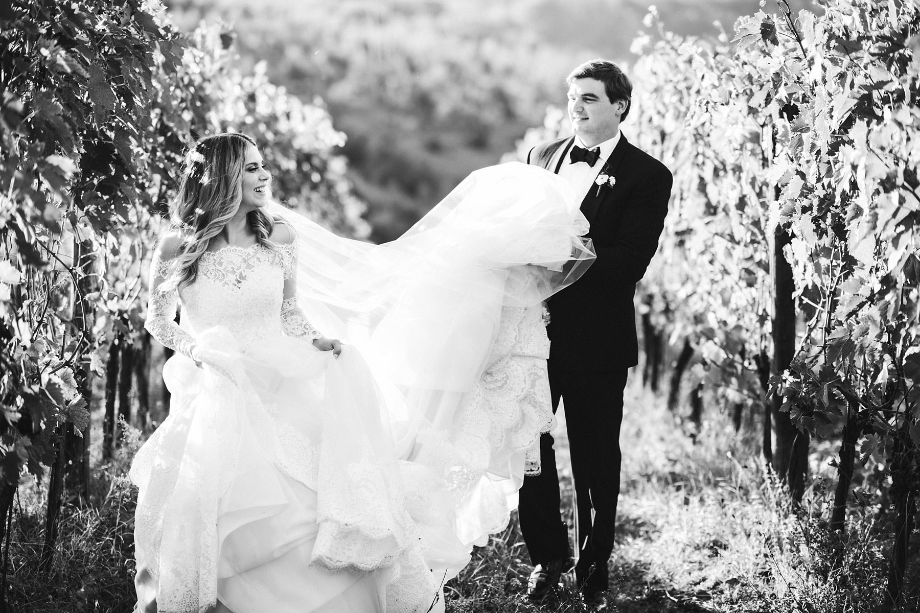 Beautiful bride and groom picture in Chianti vineyard near Villa Mangiacane. Destination wedding in Italy