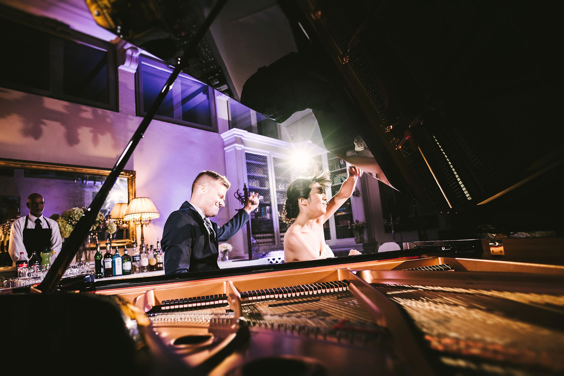Gorgeous and unforgettable live duo piano concert by bride Elizabeth and childhood friend at Villa Le Fontanelle. Intimate and elegant destination wedding in Florence