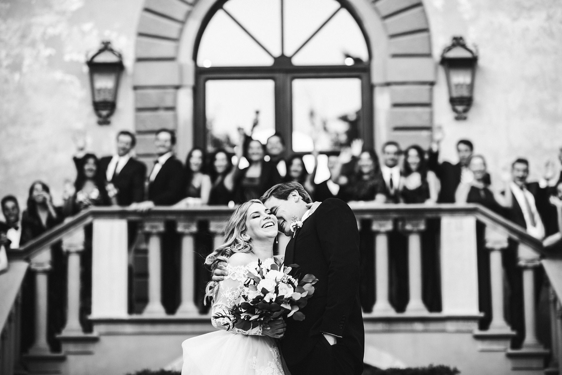 Exciting bride and groom wedding photo during reception at Villa Mangiacane in Chianti area