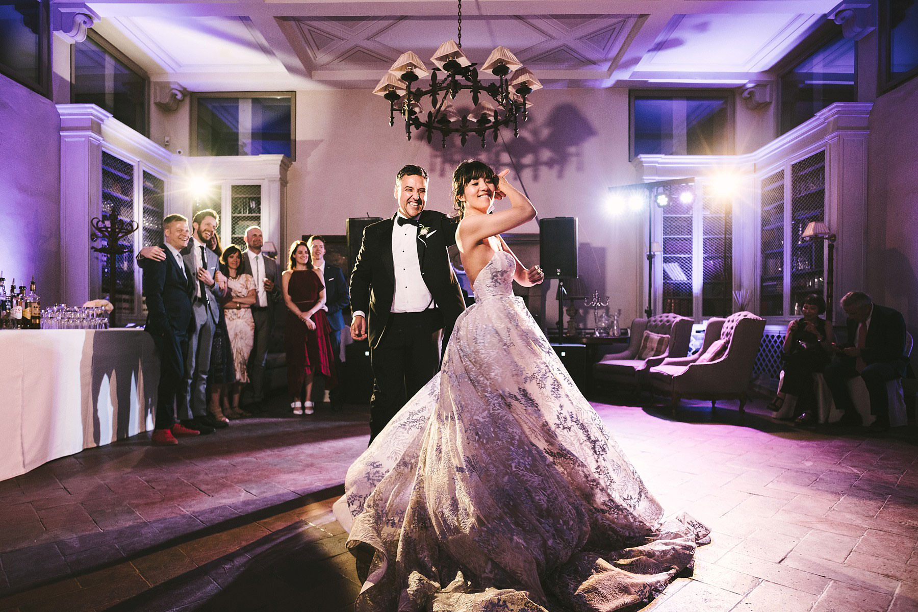 Bride and groom emotional first dance in Florence at Villa Le Fontanelle. Intimate destination wedding in Florence