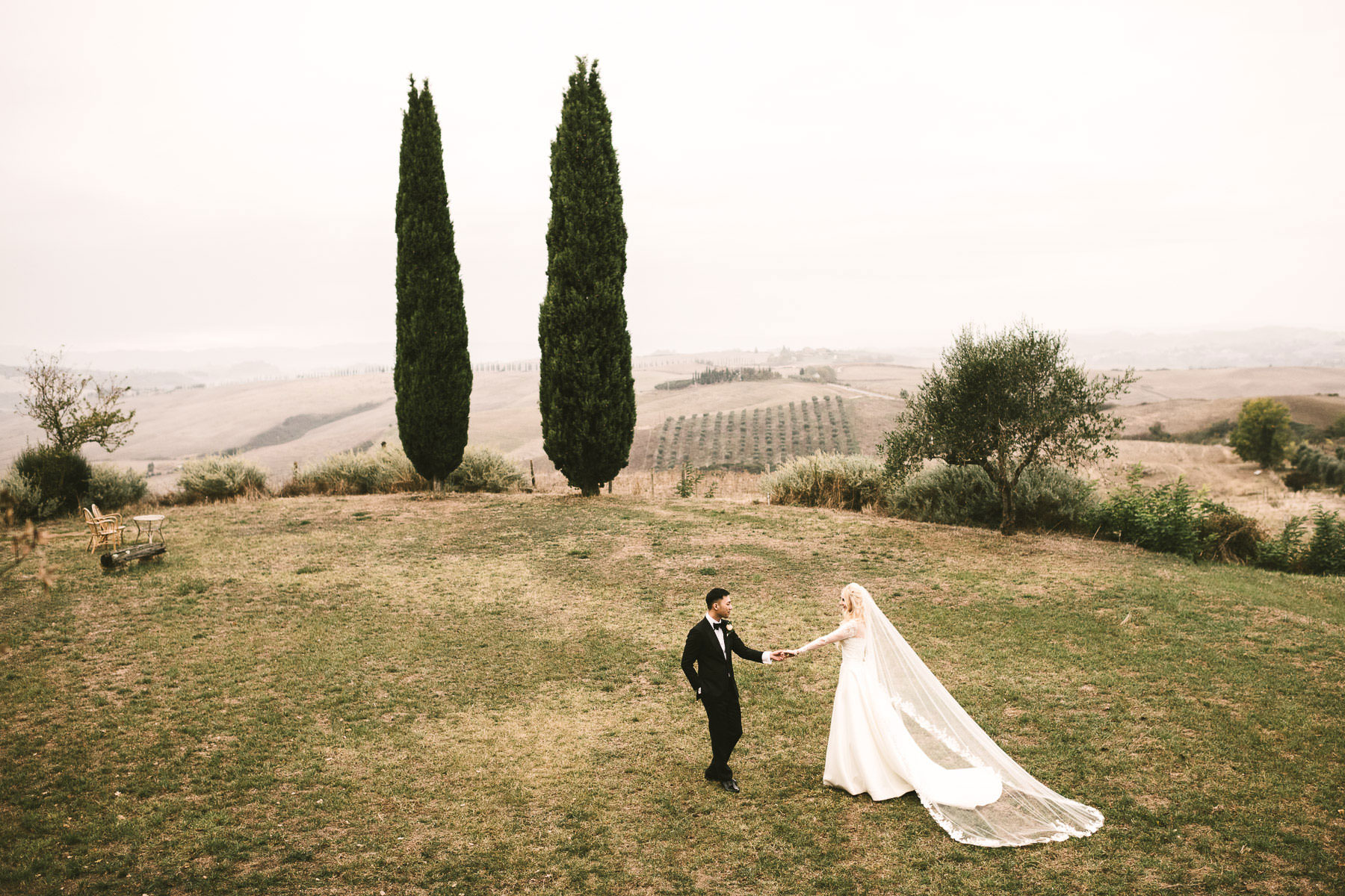 Elegant bride and groom portrait in Tuscany countryside Val D'Orcia at Podere Fornaci