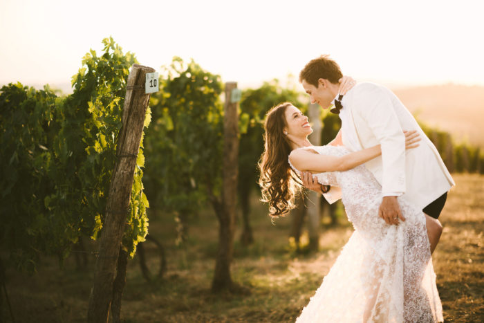 Unforgettable bride and groom portrait in a Tuscan vineyard near Panzano for destination wedding agriturismo near Panzano in Chianti