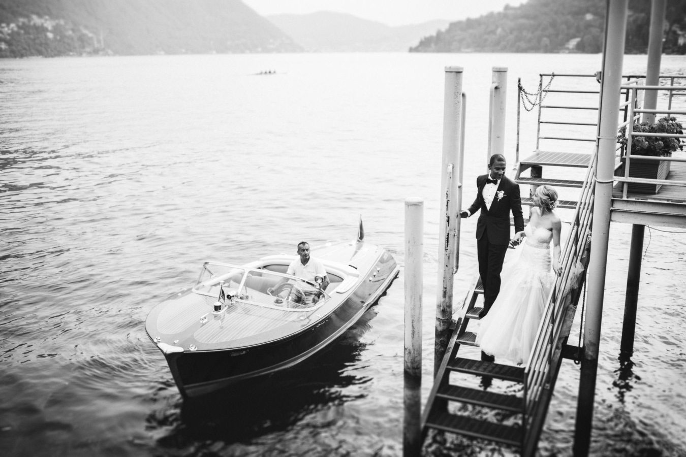 Timeless classic elegant bride groom wedding portrait Como Lake old vintage riva boat