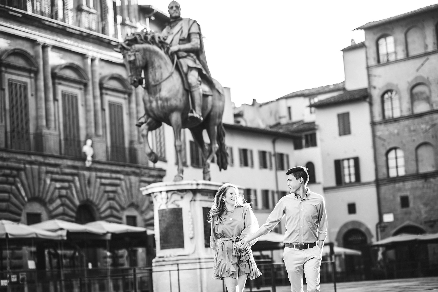 Never too young for exciting vacation photos in Florence. Early morning sunrise engagement photo shoot Piazza della Signoria