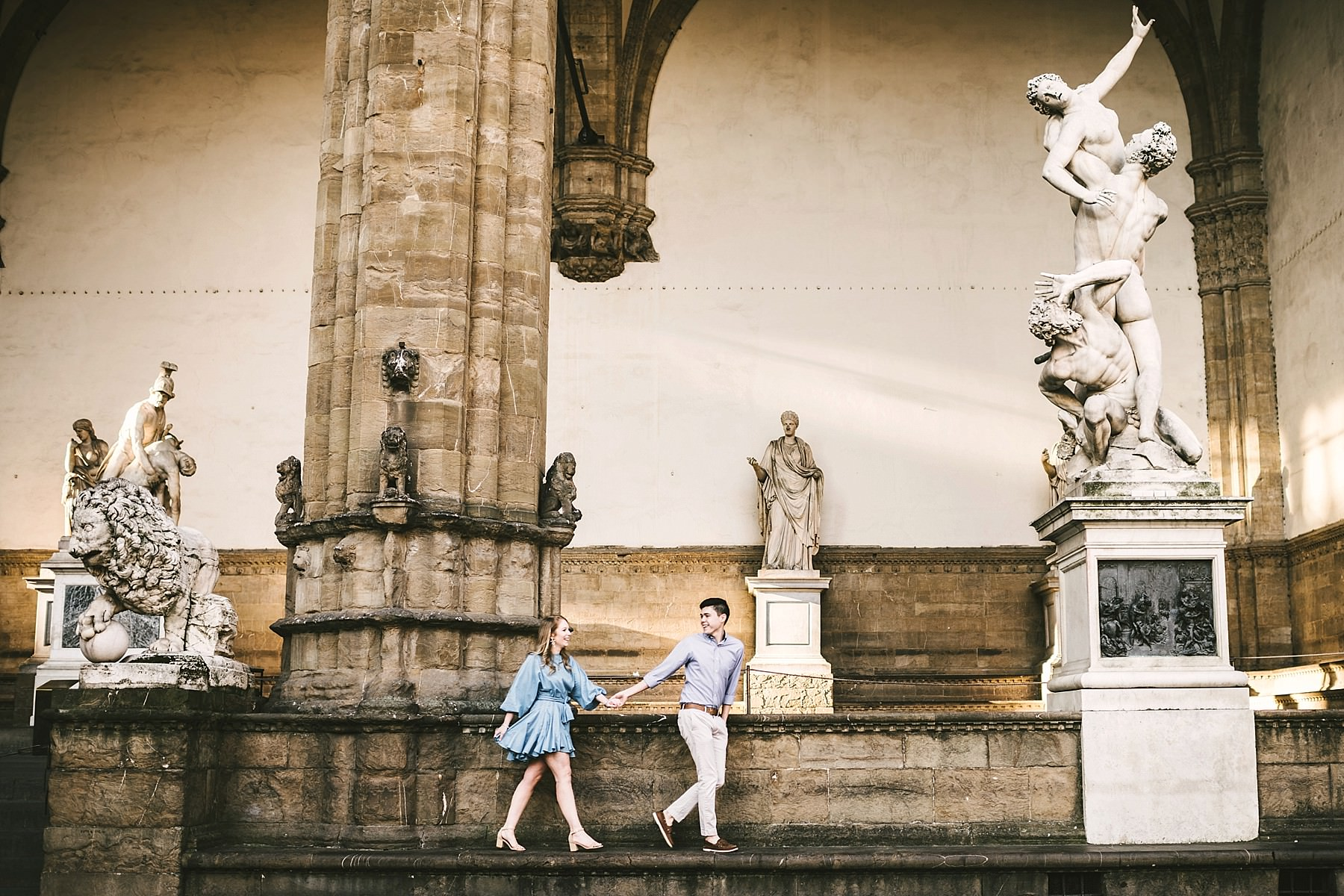 Never too young for modern vacation photos in Florence. Early morning sunrise engagement photo shoot Piazza della Signoria