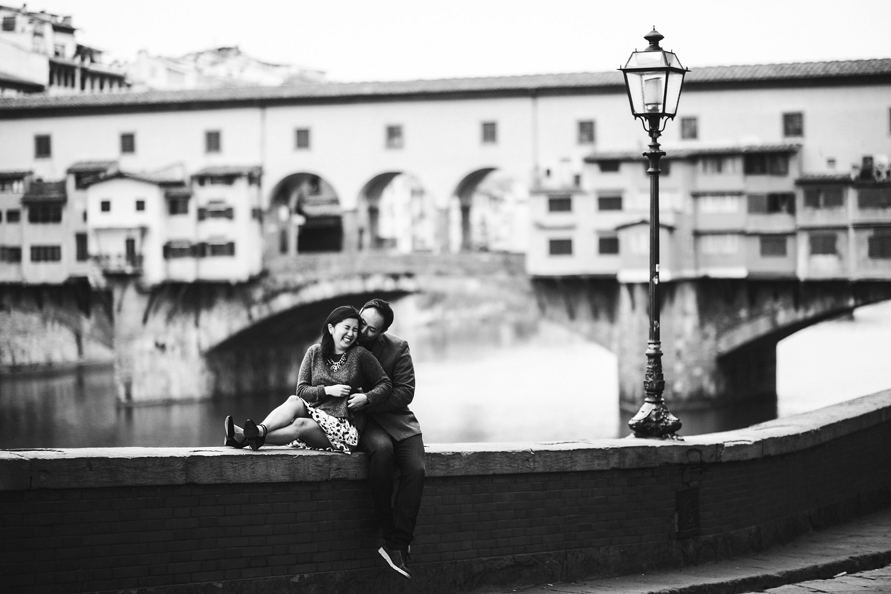 Enjoy your special vacation with a gorgeous professional photo session. Sunrise with no crowds engagement pre-wedding photo shoot in Florence at Ponte Vecchio